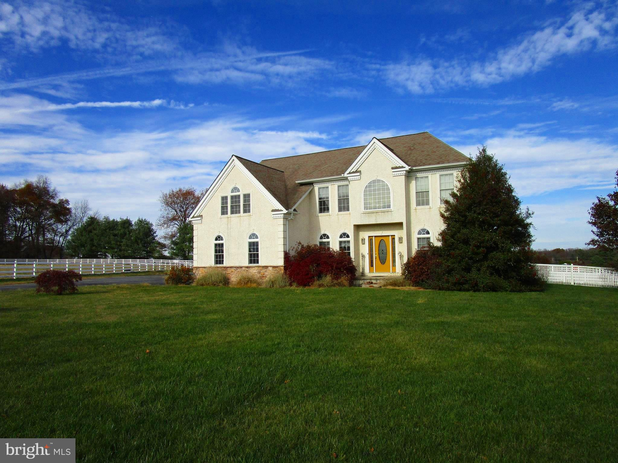 In the Fair Hill area this impressive setting on a slight hill with detached 4 car garage with back