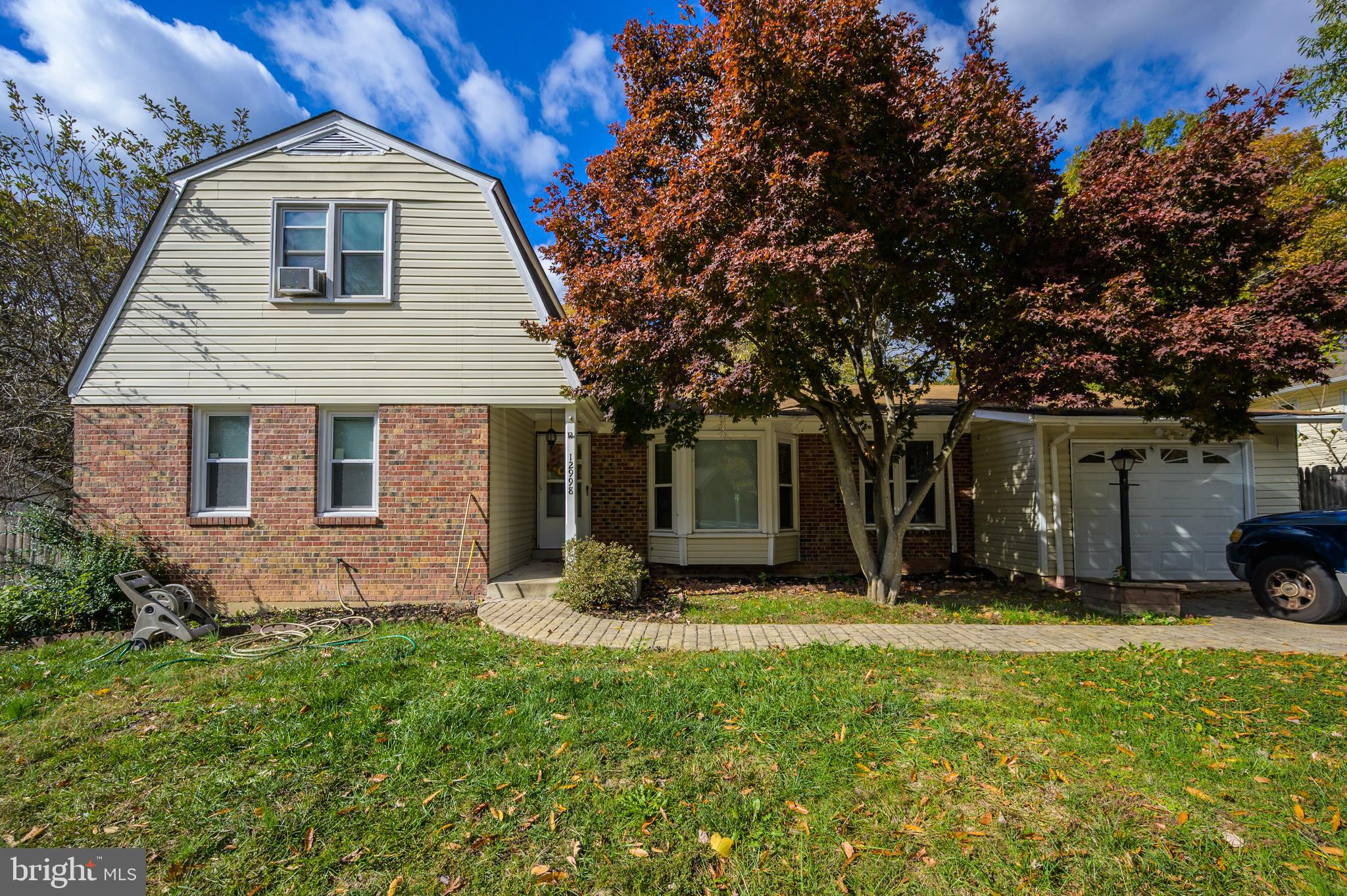 Tremendous Opportunity With This Dutch Colonial In Lake Ridge! No HOA! Fully fenced yard with in-gro
