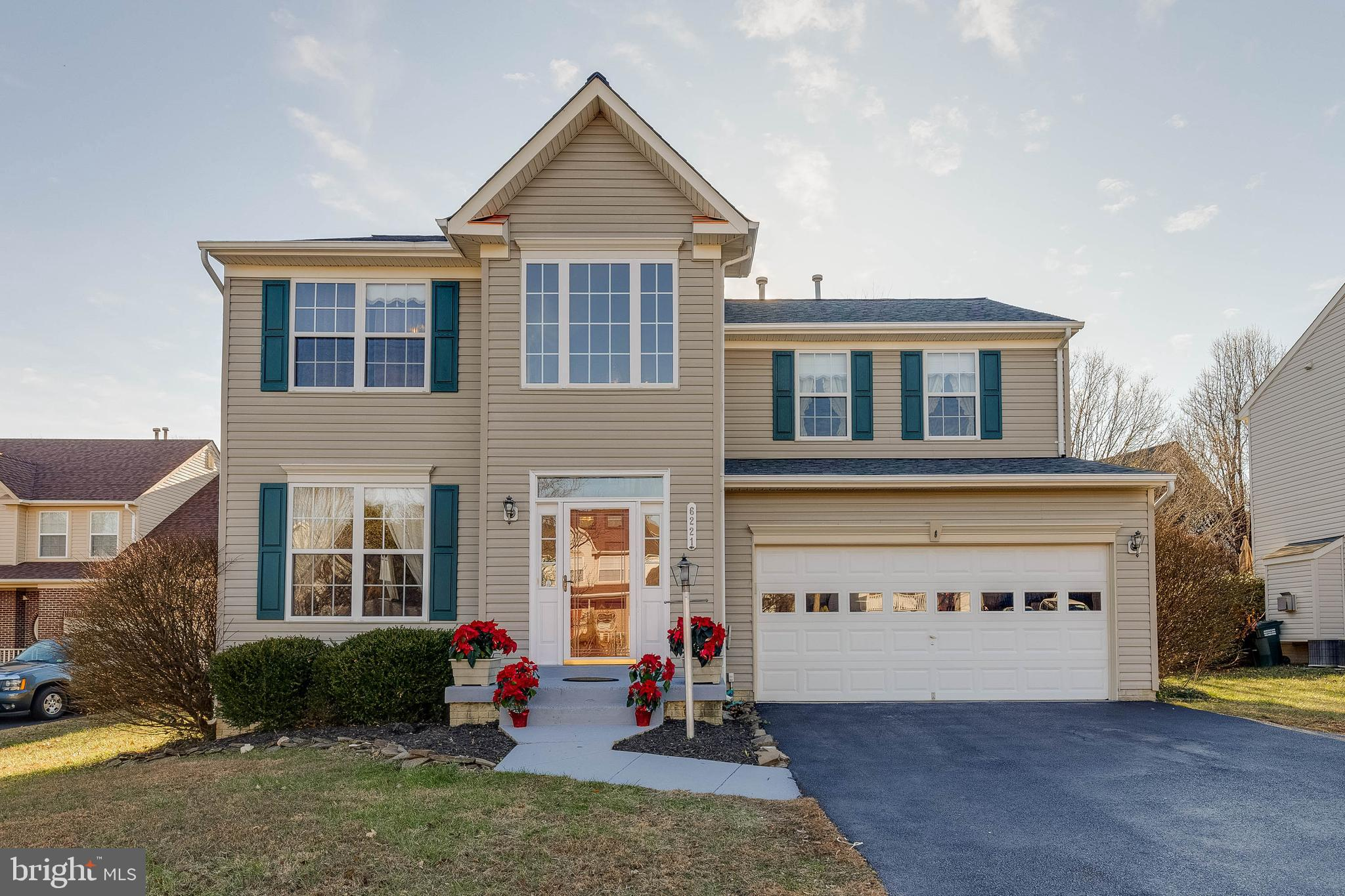 Beautiful three-level home with over 3600 sq ft of finished living space with two-story foyer: Recen