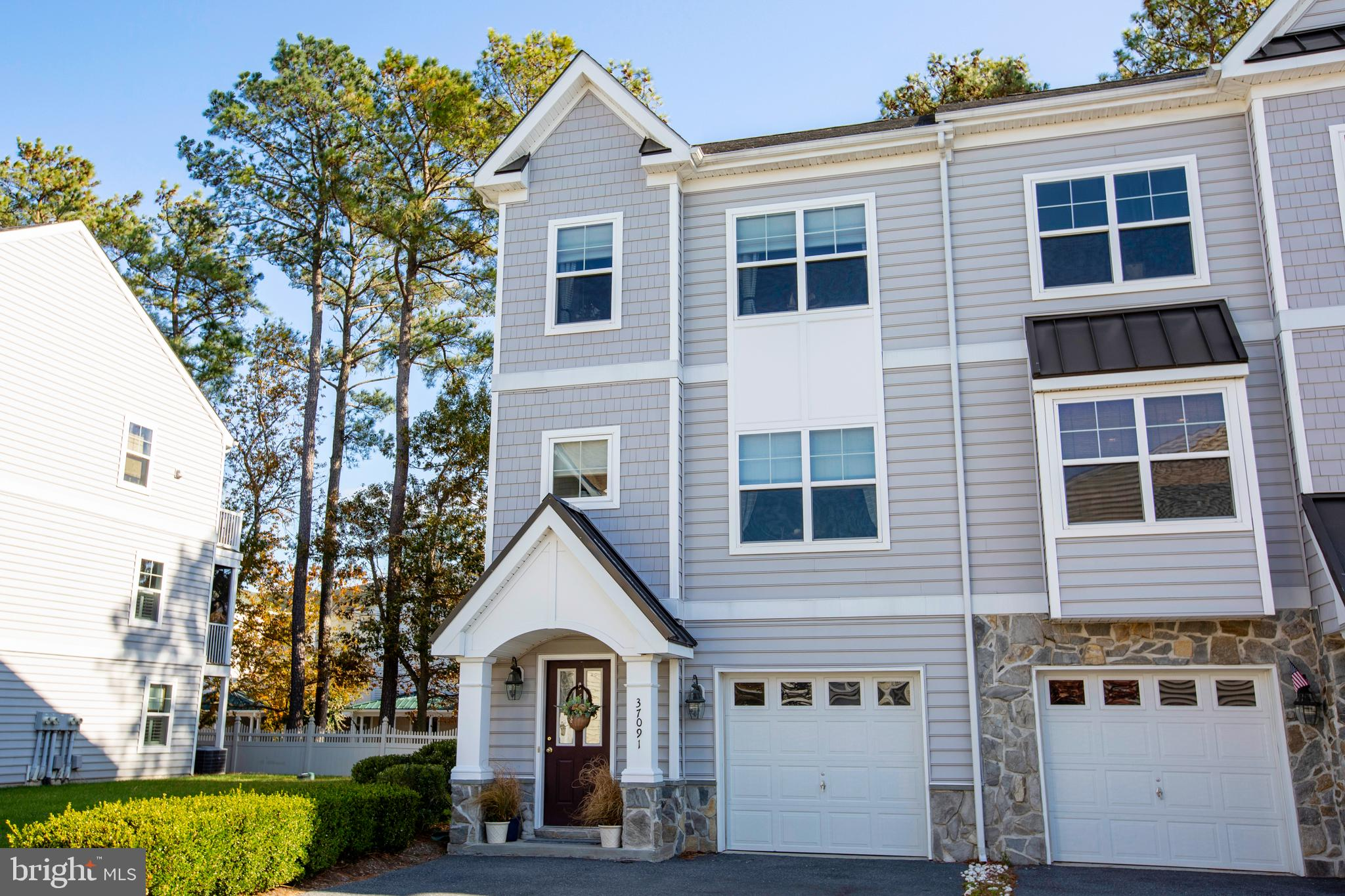 East of Route 1- Beautiful 3-story  end unit townhouse with open space next door making pet ownershi