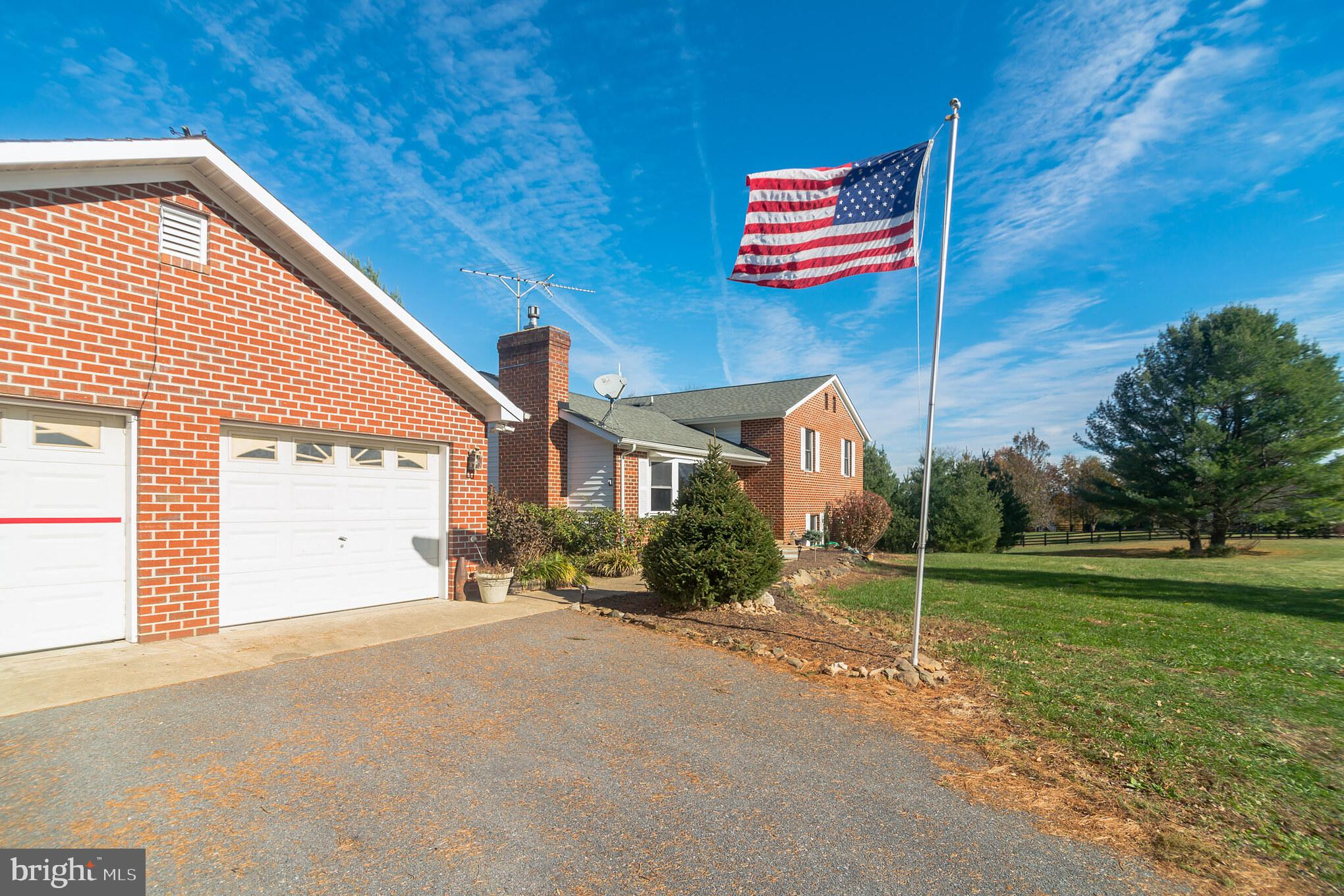 Beautiful split level home in Lovettsville on almost 5 acres. Bring your horses or cattle. Already f