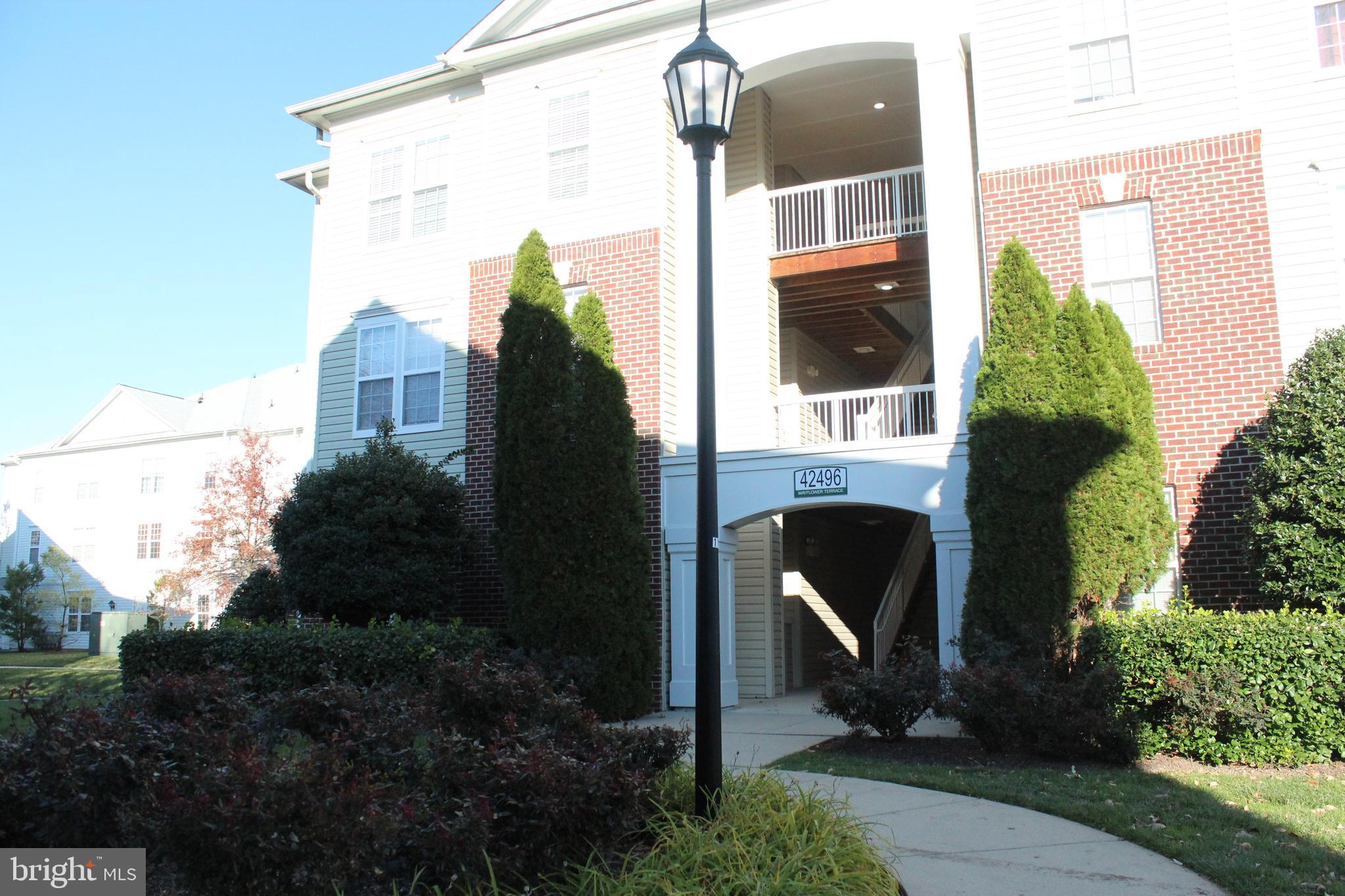 Updated First floor PATIO unit  sought after Summerfield at Brambleton. Fresh new Trendy paint and N