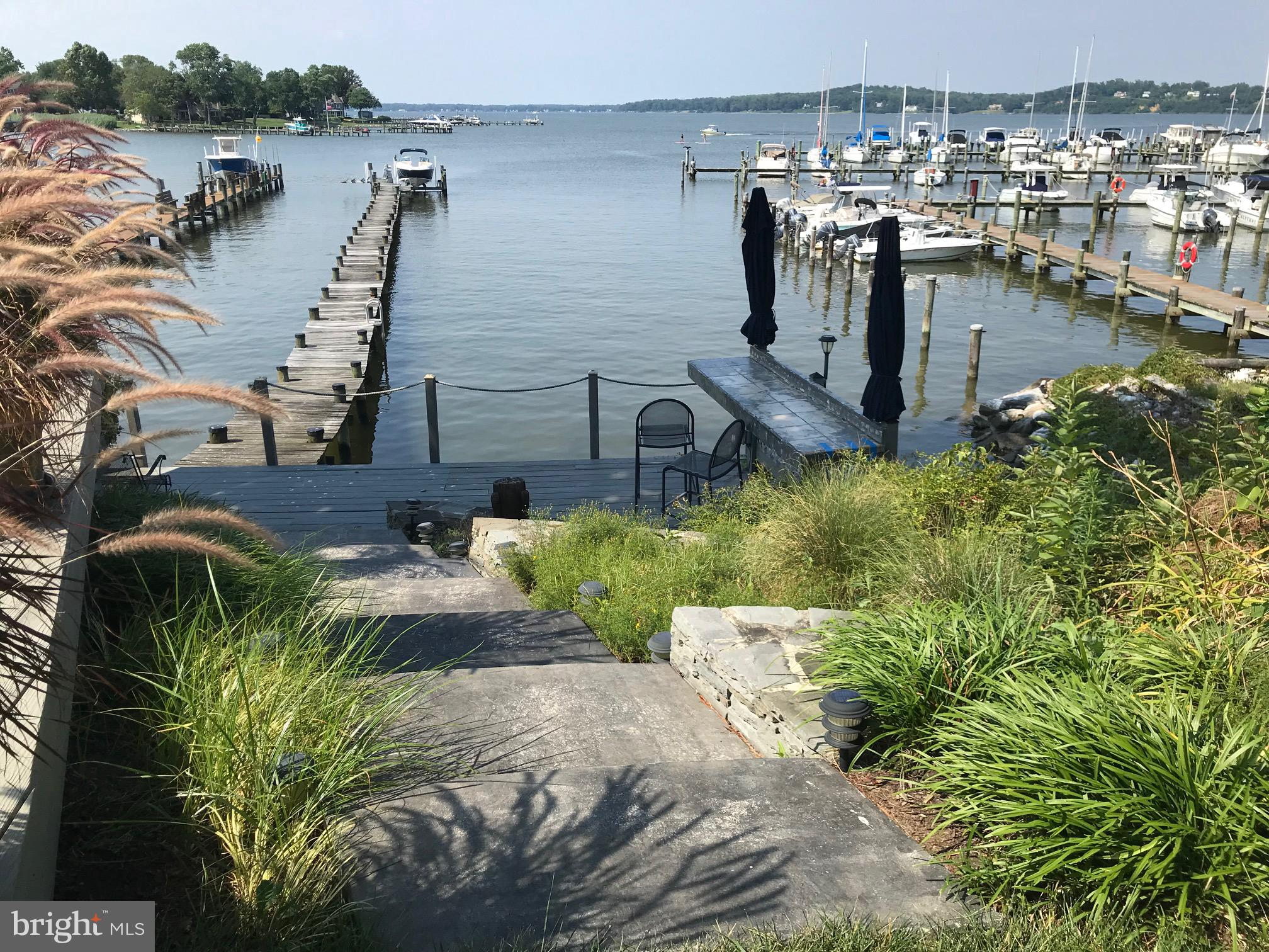 Spectacular views of the Magothy from this gorgeous 4 bedroom, 3 bath waterfront home with 1998 squa
