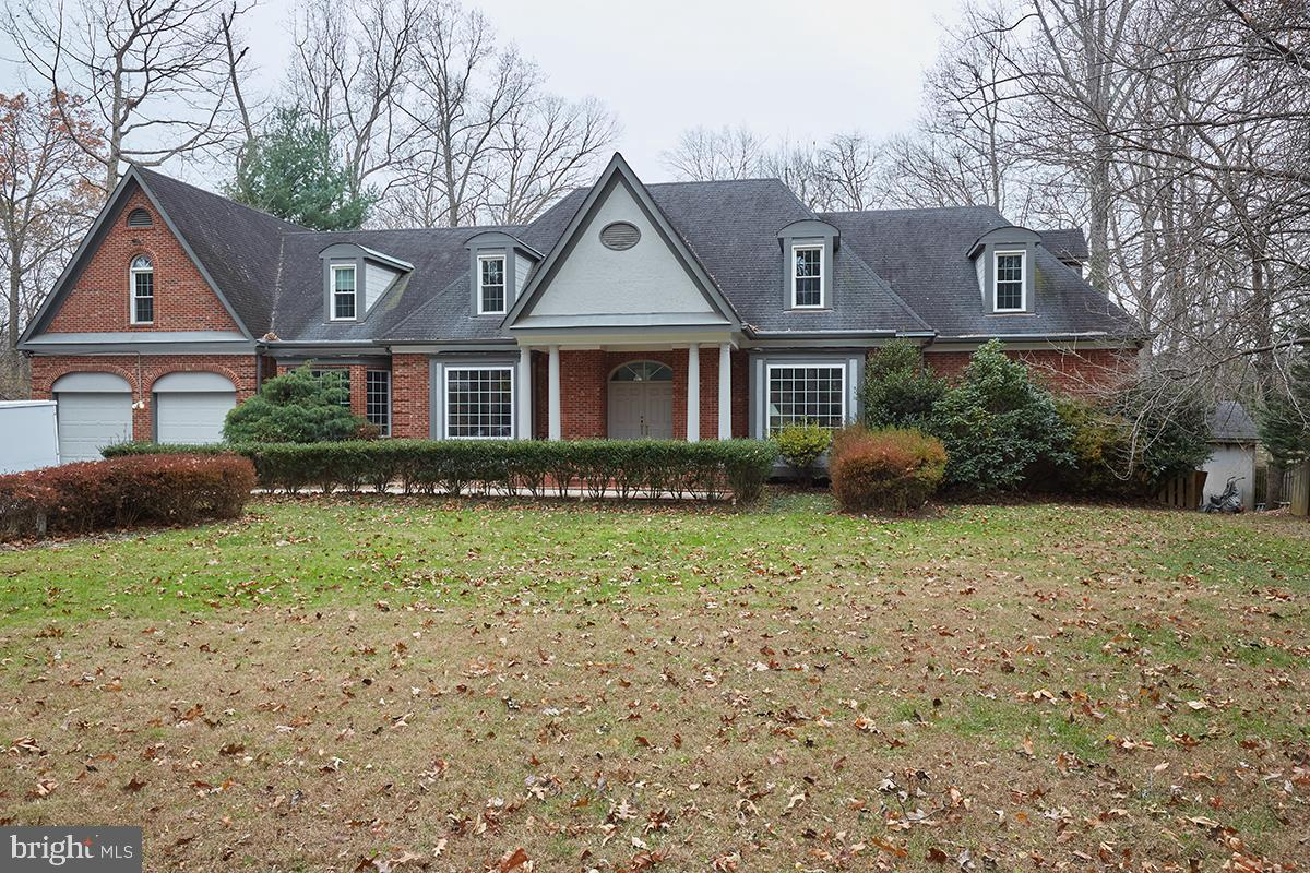 Woodson High School Pyramid!  Stunning Space! Custom Normandy Styled Residence on one acre.  Enter t