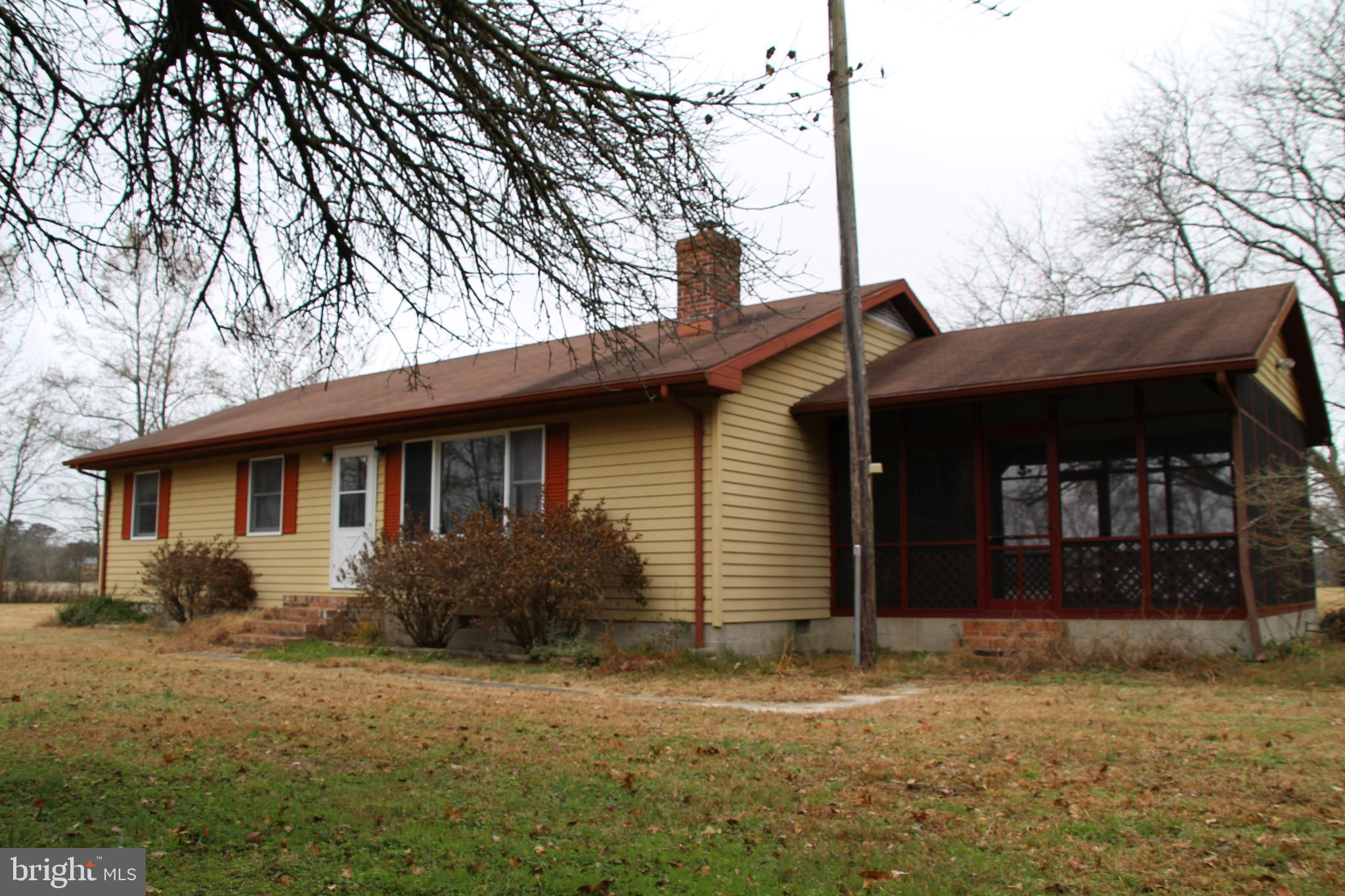 Well-kept Rancher Home on 5+ Acres in the country, but very close to town.
