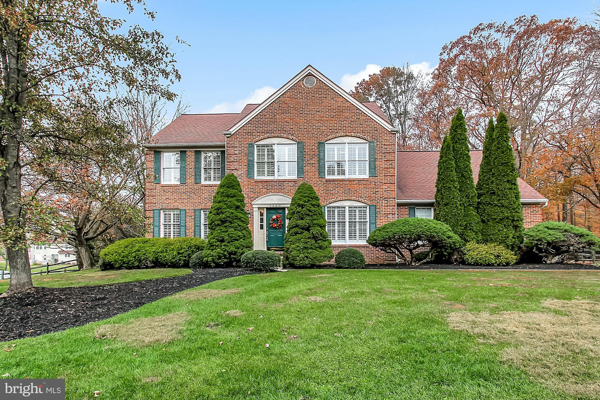 Beautiful large brick Colonial! Gorgeous fenced rear yard backing to tree lined pond and stunning in