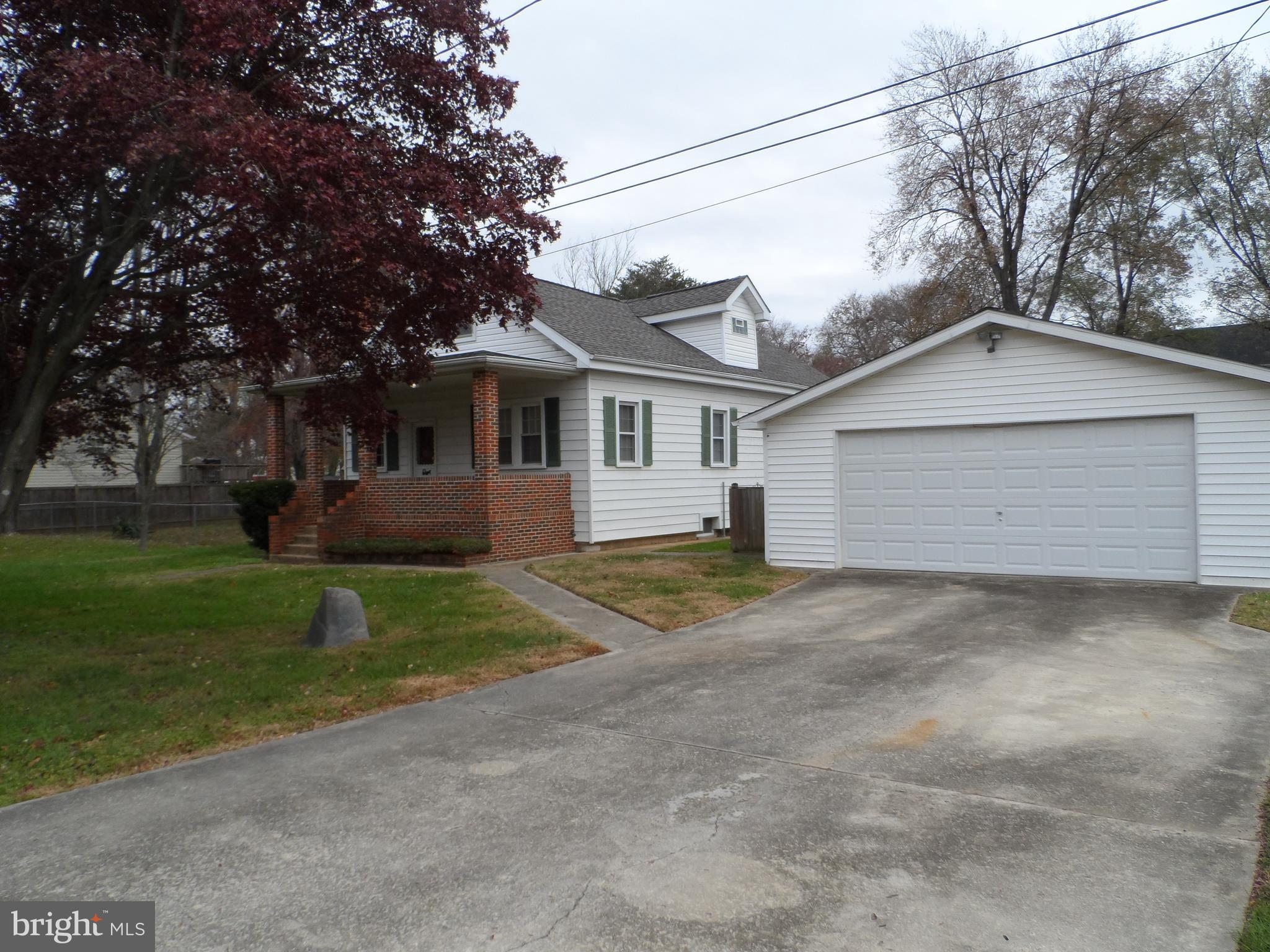 4 Bedroom 2 Full bath Cape Cod located on over 0.38+/- acre lot, which INCLUDES EXTRA BUILDING LOT!