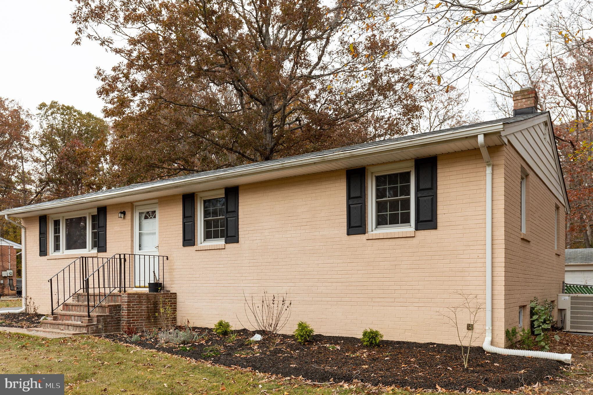 Charming 3 bed 2.5 bath rambler on nearly an acre lot that includes a four car garage with a wood st