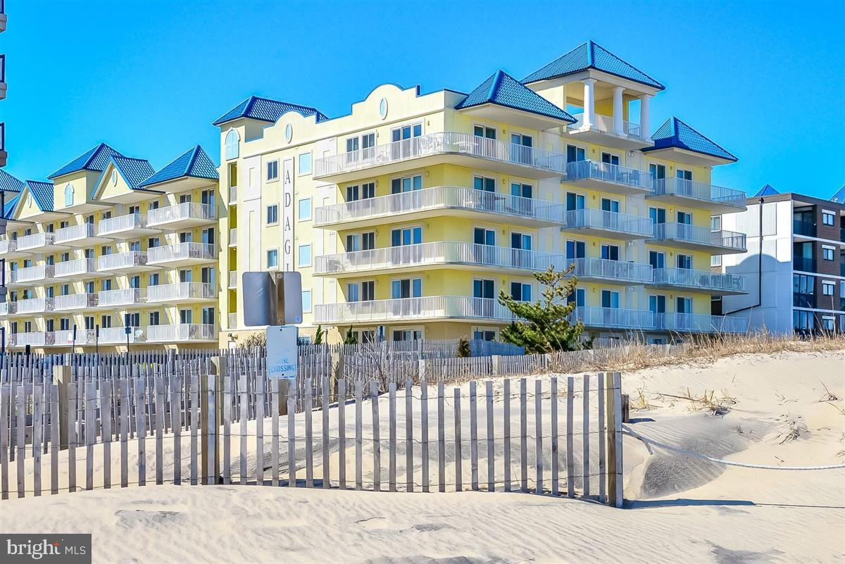 Gorgeous 3 Bedroom, 3 Baths in the Adagio Condominium on 59TH Street Ocean Front Building, Offering Excellent Ocean & Beach Views,  SOUTHERN EXPOSURE, This Unit is  TOTALLY TURNKEY and in Excellent Condition, OUTSTANDING RENTAL INCOME of $45,000 PLUS  in 2019. New Owner must Honor Booked Rentals for 2020.  This Unit has been Completely updated with New Stainless Steel Appliances in Kitchen, New Washer & Dryer,  New Armstrong Laminate Non-Scratch Flooring,  ALL NEW COASTAL BEACH FURNITURE, New Room Darkening Draperies, New Water Heater, New Front Door with Digital Lock, New Ceiling Fans,  HVAC was replace in 2014,  This Open Floor Plans is Very Bright & Airy and has a  Natural Gas Fireplace, Each Bedroom has its Own TV,  This Unit is Ready to Go, This is a Must See, The Adagio also has a Heated, Year Round indoor Pool, Workout Room, Meeting Room for it Owners, Pet Friendly, and Conveniently Located Mid Town and Walking Distant to Some of the Best Restaurants & Bars in Ocean City,  Covered Parking for 1 Car plus Open Parking for Second Car and overflow..... Buy Now and Starting Collecting Rental Deposits for 2020......You Will Love this Unit!! Condo  Association Pays for Natural Gas for Fireplace