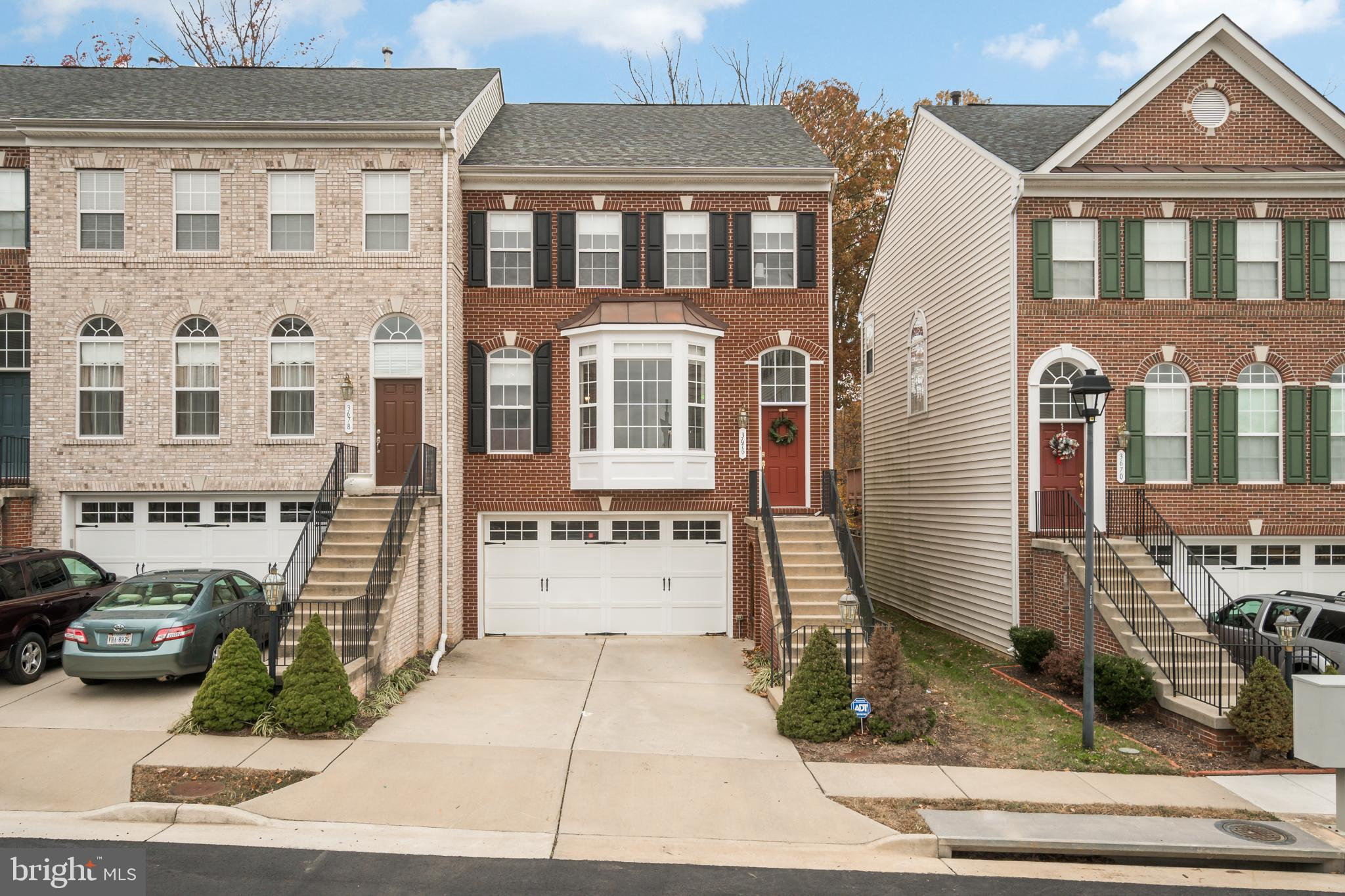 Largest home in the community!  Expansive 3 level end-unit townhome with a bump-out upgrade on each