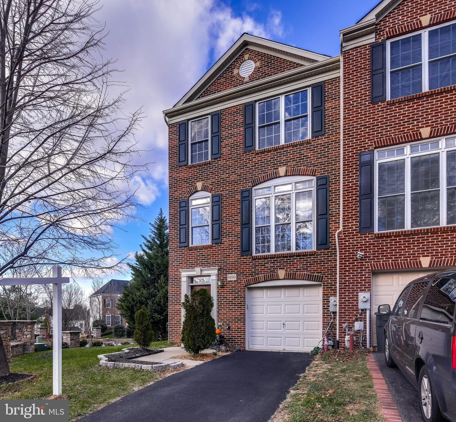 Beautifully maintained brick end unit townhome in Montjoy.   Hardwood flooring on the entire upper l