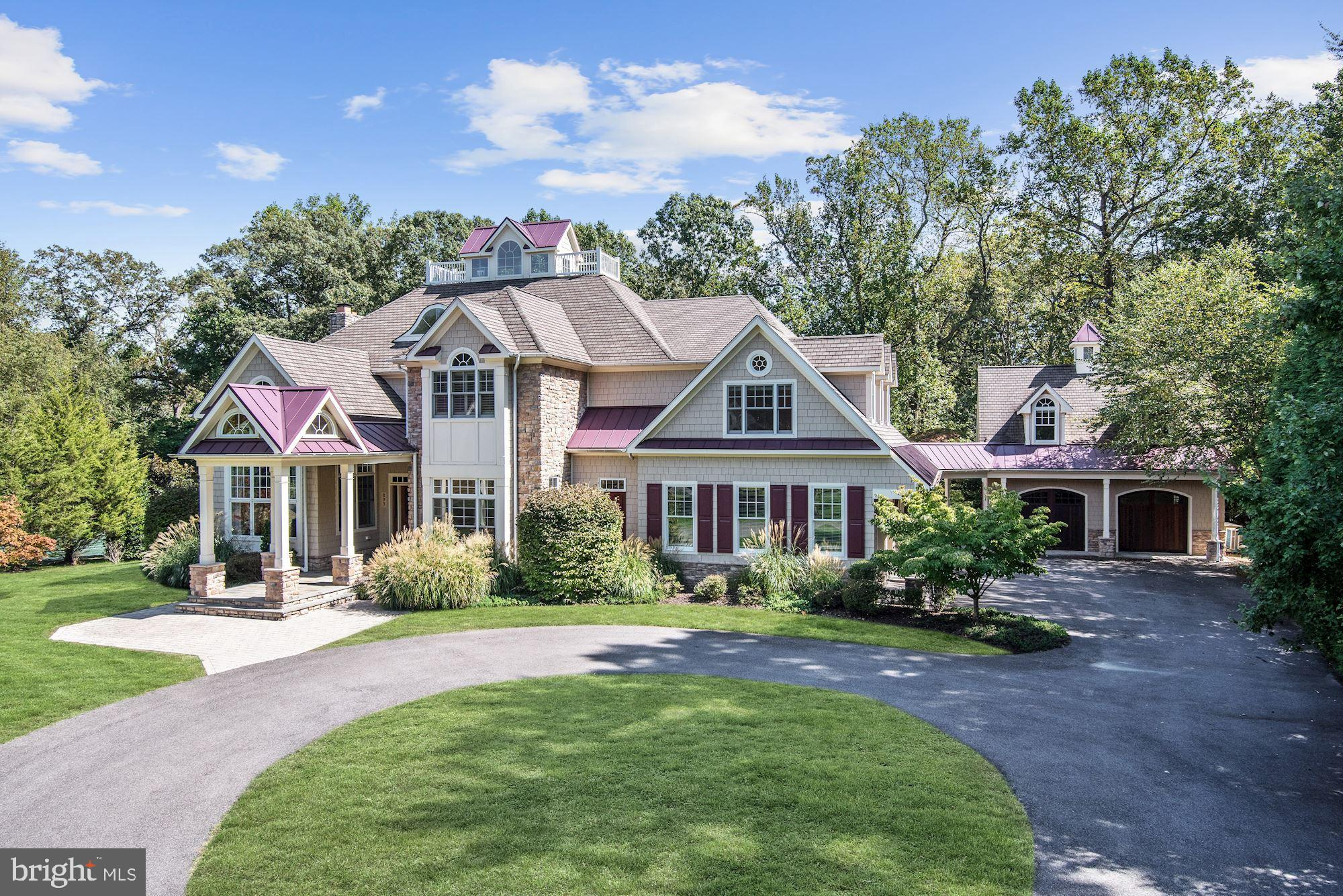 This IMMACULATE home sited on a 3-acre lot in a beautiful gated community has lavish details and end