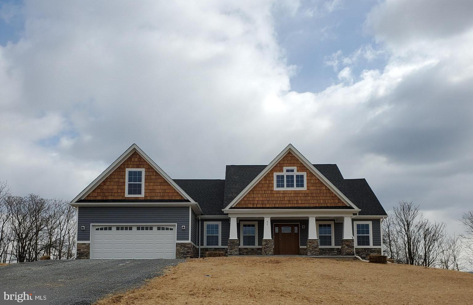 Under Construction ranch style home with mountain views. Quality construction in great location. Roa