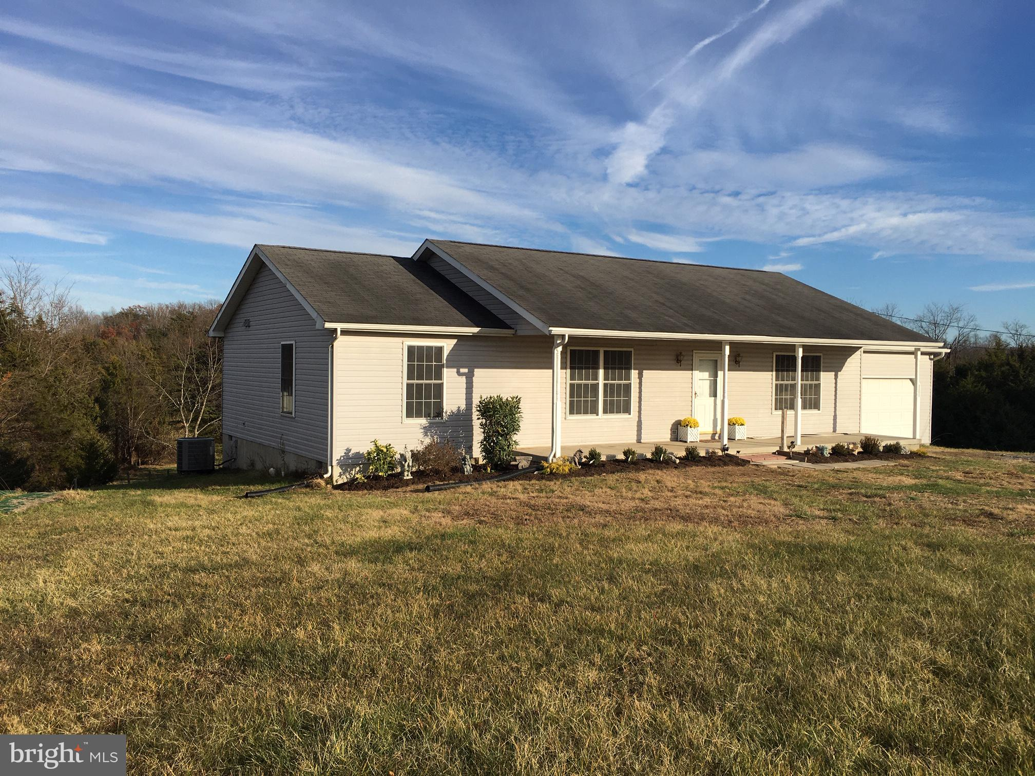 Completely Remodeled! Open concept Ranch Country Home on 5 acres in rural Stephens City, VA - perfect for the Equine enthusiast or start your Farmette! 3 Bedroom, 2 Bath, 1492 sq ft with attached garage & automatic door opener, . Nestled in the Norther Shenadoah Valley with Spectacular mountain views on horizon over open pastures.Nice country home all on one floor - Simple Luxury!All LED lighting throughout home with dimmable Kitchen light. Motion light upon entry from garage so no hands needed to turn a switch when you hands are full. Hardwood flooring throughout with tile in kitchen, both baths and laundry room. Upgraded Kitchen with High end, solid wood, extra tall cabinets. Brushed Nickel fixtures, Soft close toilet seats/lids. New electric smoke detectors with battery back up. Ducts cleaned and sanitized. This home is move-in ready!!Very close to I-81 & I-66. Convenient to Schools, Shopping and very nice Parks