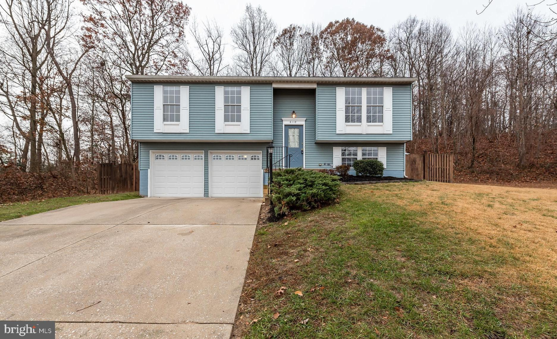 Move-in ready home is perfectly set on a private cul-de-sac! Fresh paint, new carpet, kitchen update