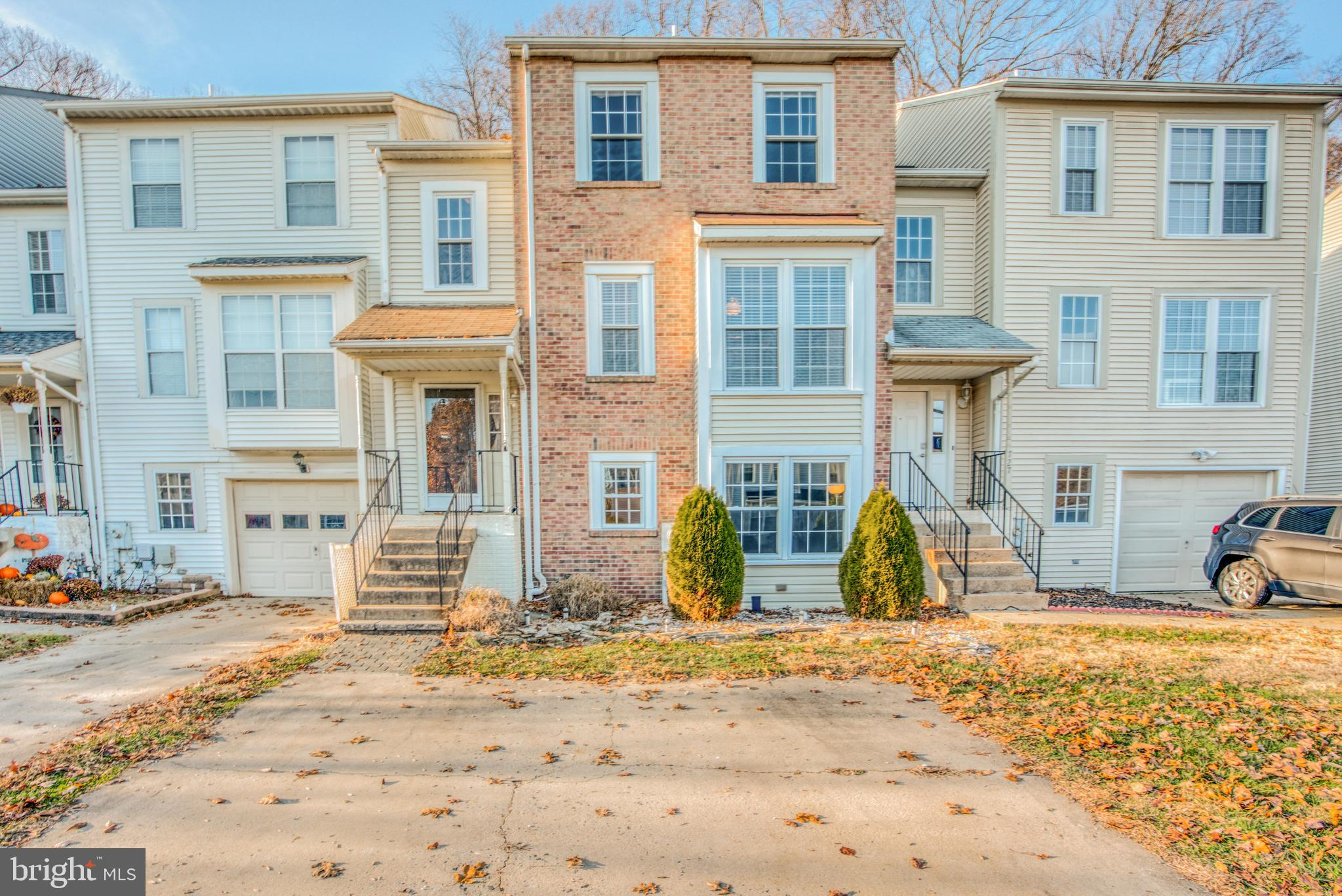Welcome to 729 Farnham Place! This move in ready brick front 4 bed 3.5 bath townhome boasts beautifu