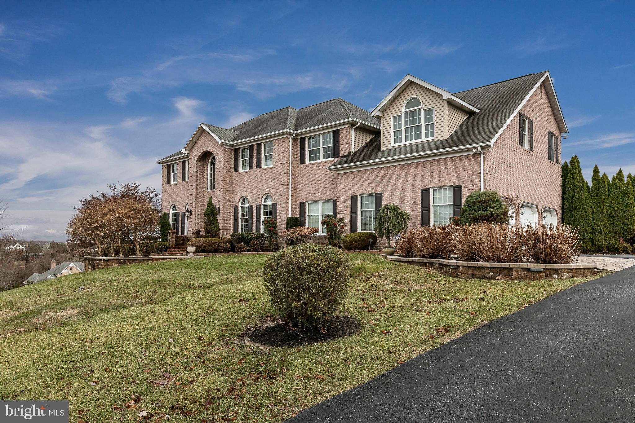 Exquisite 5 BR 3.5 BA  All brick colonial w/ 3 car garage in gorgeous Falls Crest.   The property si