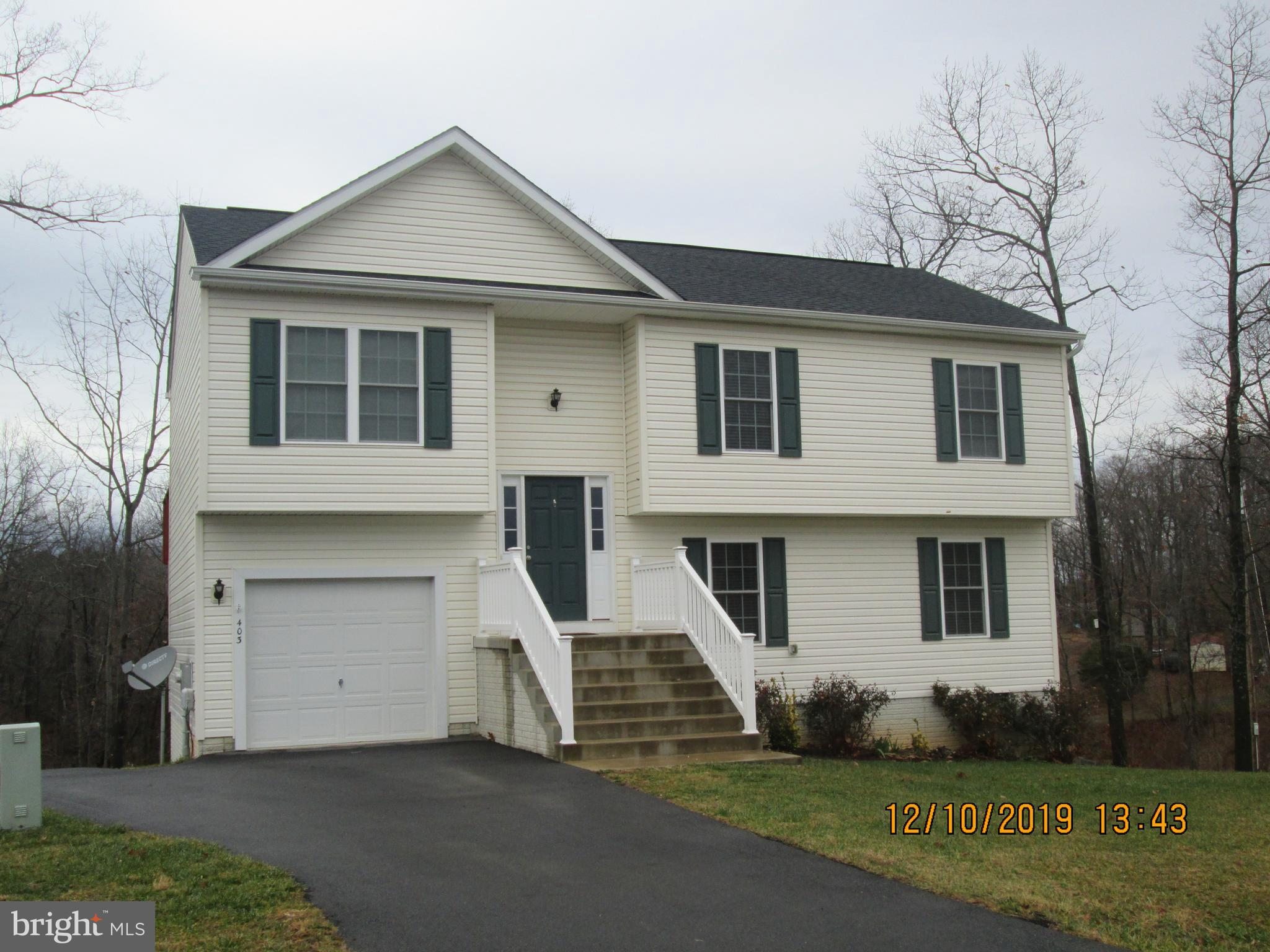 This 4 BR, 3 full bath split foyer home is just like new! Spacious home is move in ready. Features a