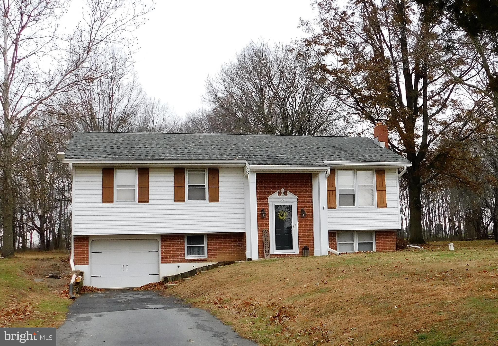 Large Bi-Level home on a cul-de-sac sits on 1.67 acres.  Sold with lot to the left of the home  - an