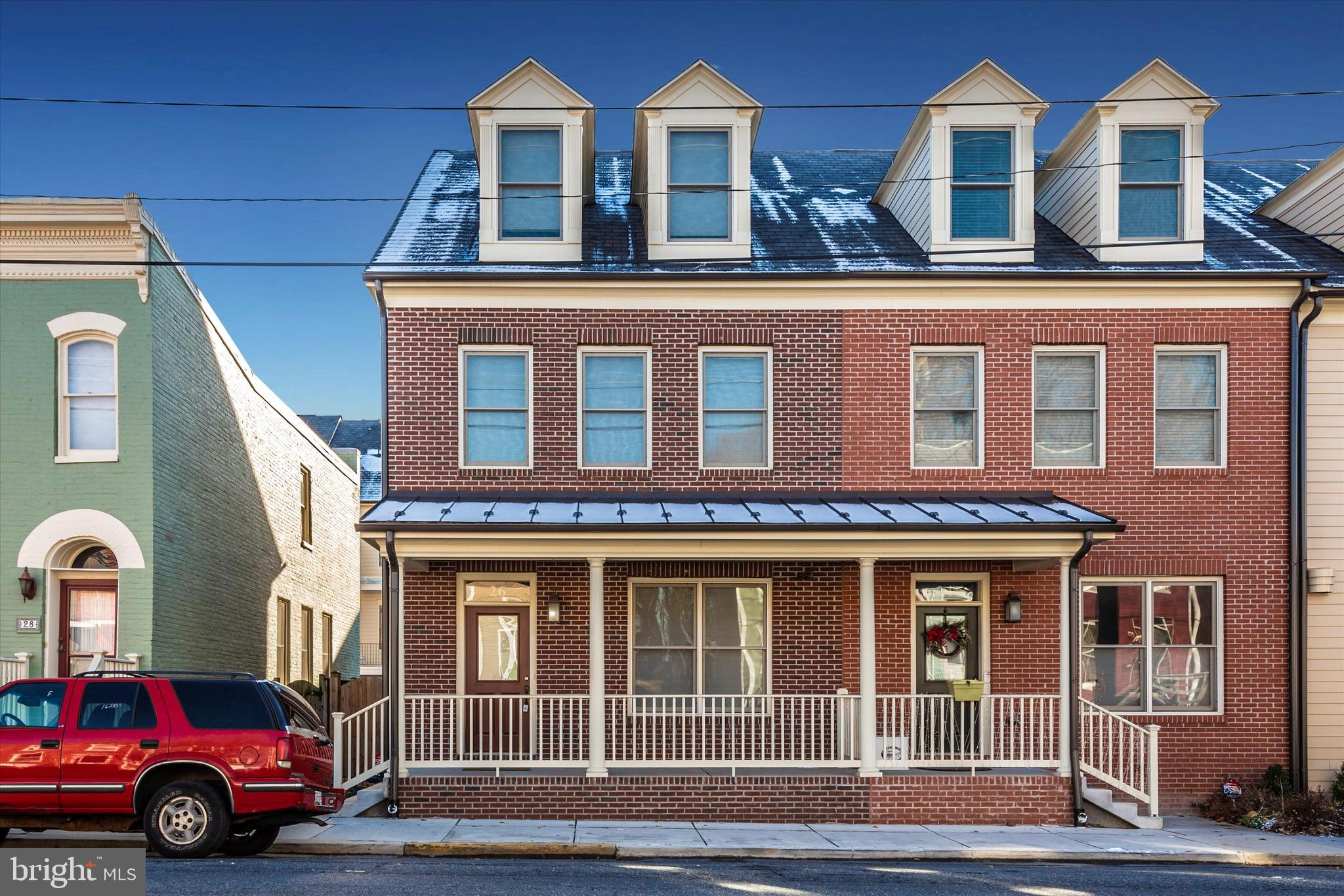 This stunning Maxwell Square end unit townhouse in downtown Frederick will blow you away!  Fall in l