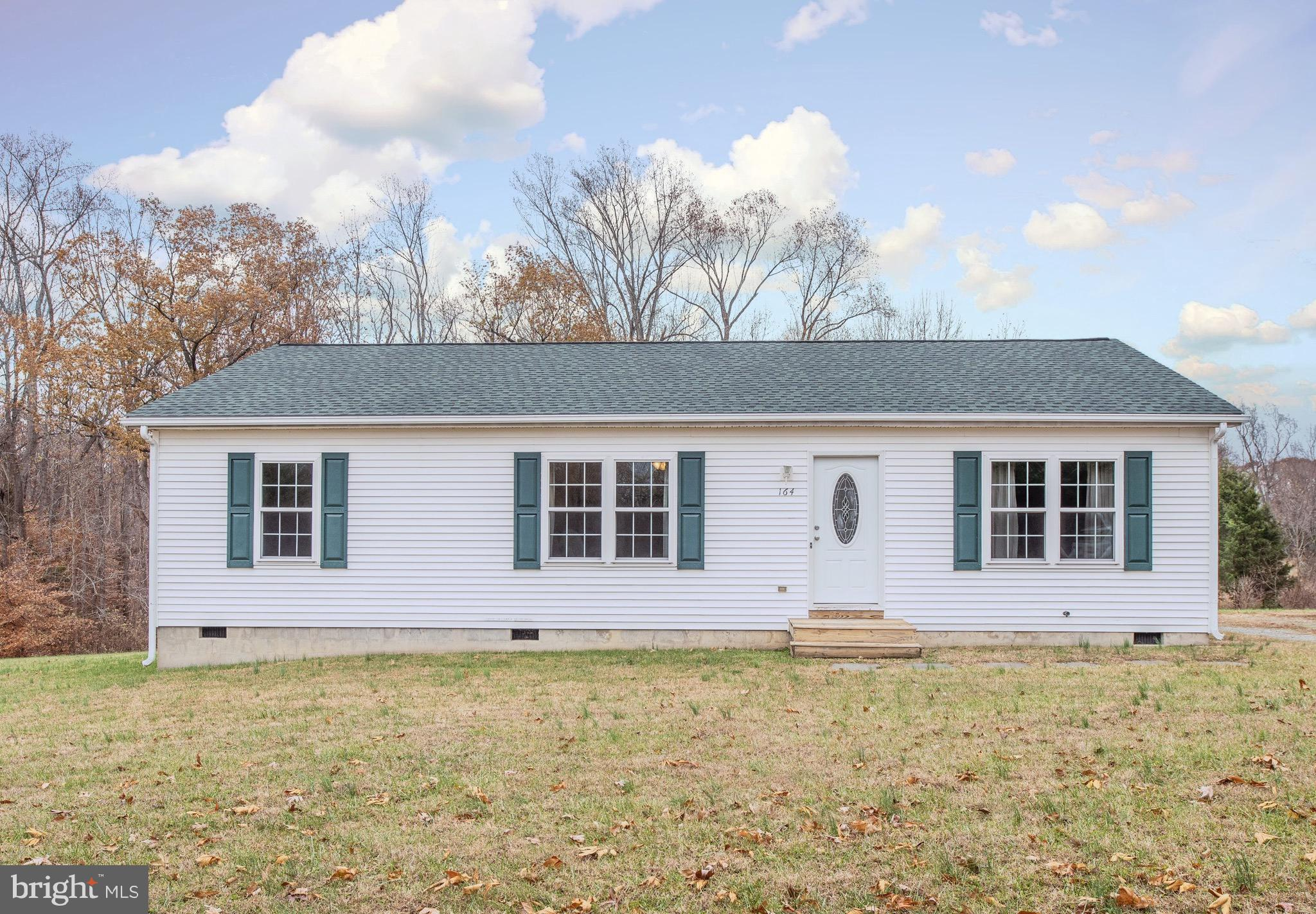 ONE LEVEL LIVING IN A QUIET COUNTRY SETTING YET VERY CLOSE TO VRE, I95, DOWNTOWN AND SHOPPING IS A M