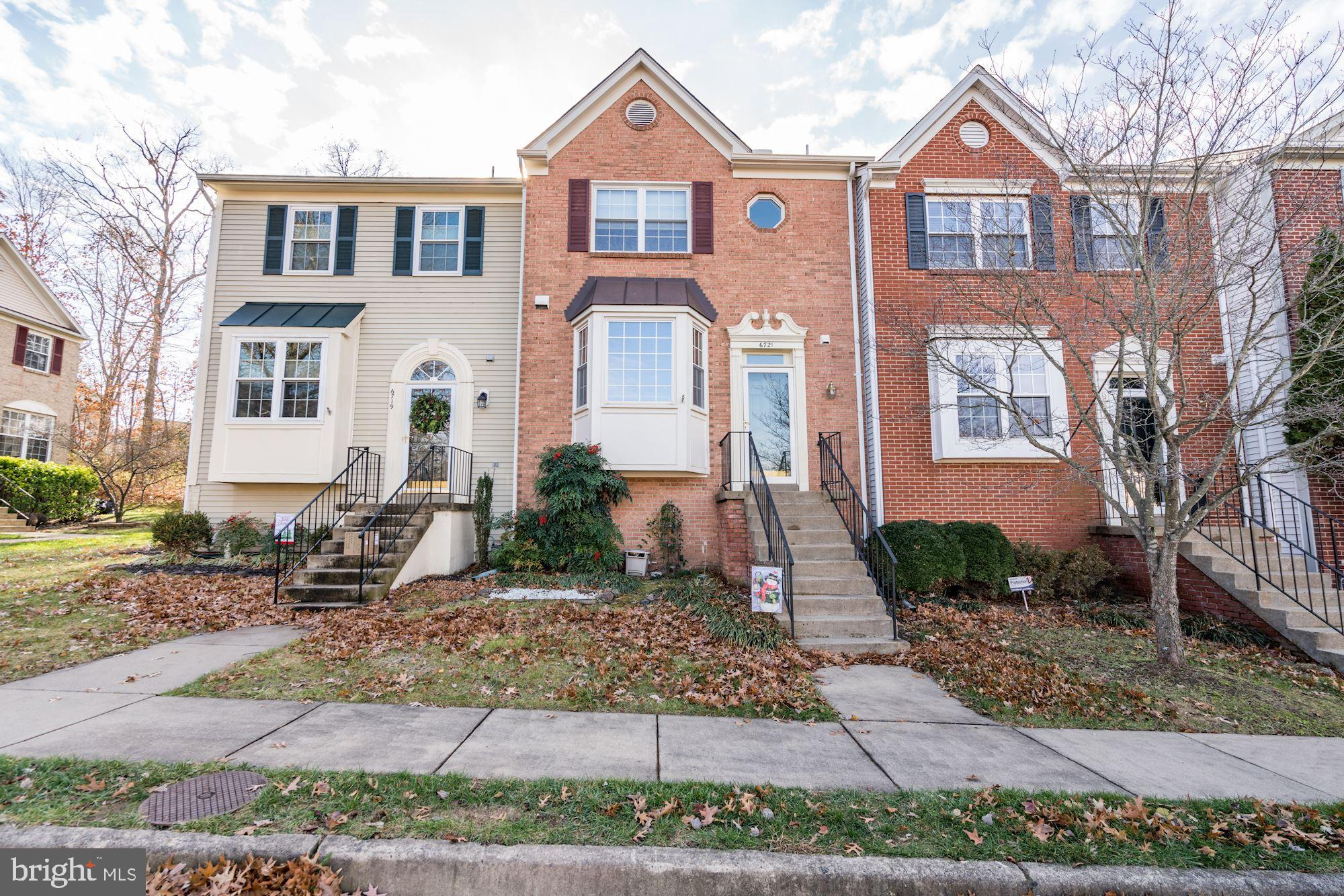 GORGEOUS  Brick Front Town home! Beautifully remodeled kitchen with granite and stainless appliances