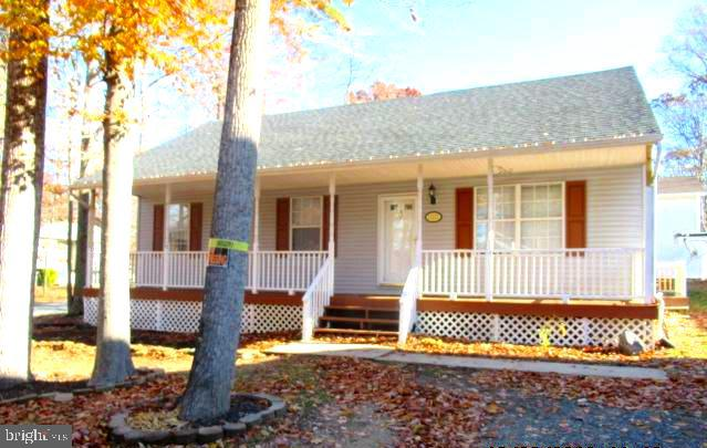 Located in the community of Chesapeake Ranch Estates.  This Three bedroom two full bath home is site