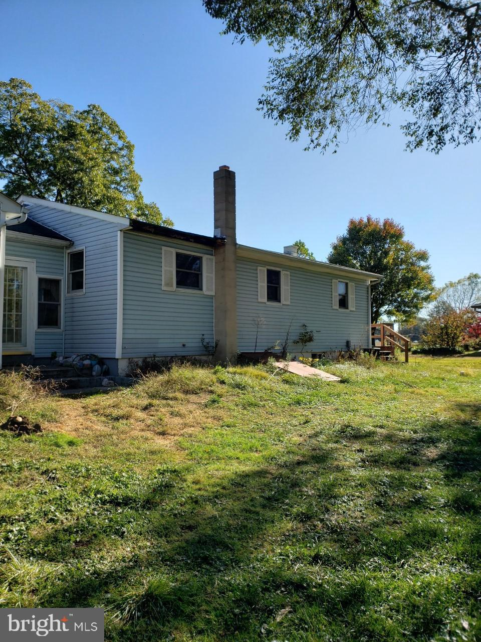 3 bedroom 1 bath rambler on over a 1/2 acre. Great opportunity to make this your own with some TLC.