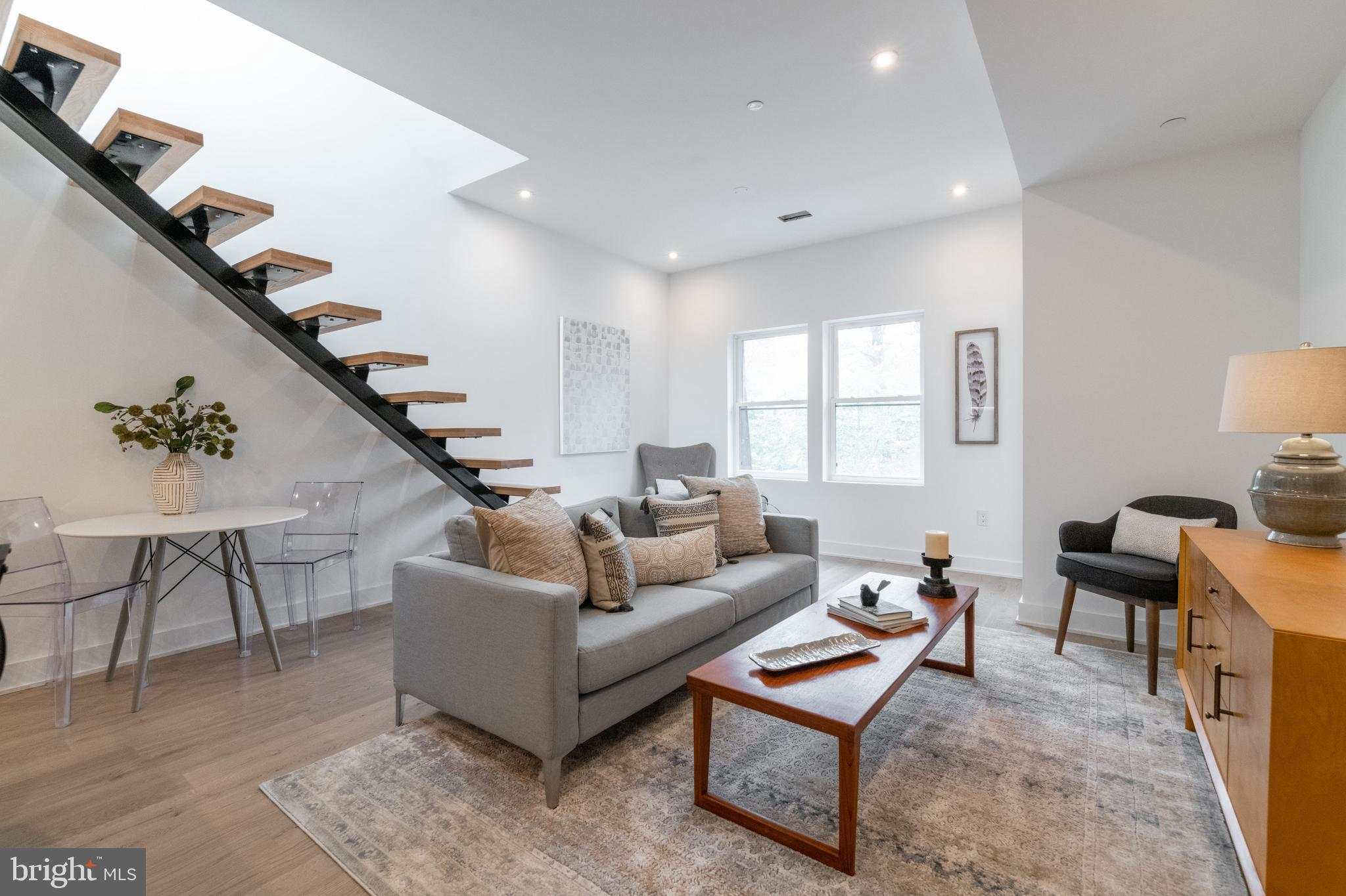 Open Sun. 1-3. One of two penthouse units at Rose Condominiums, with a floating staircase leading to
