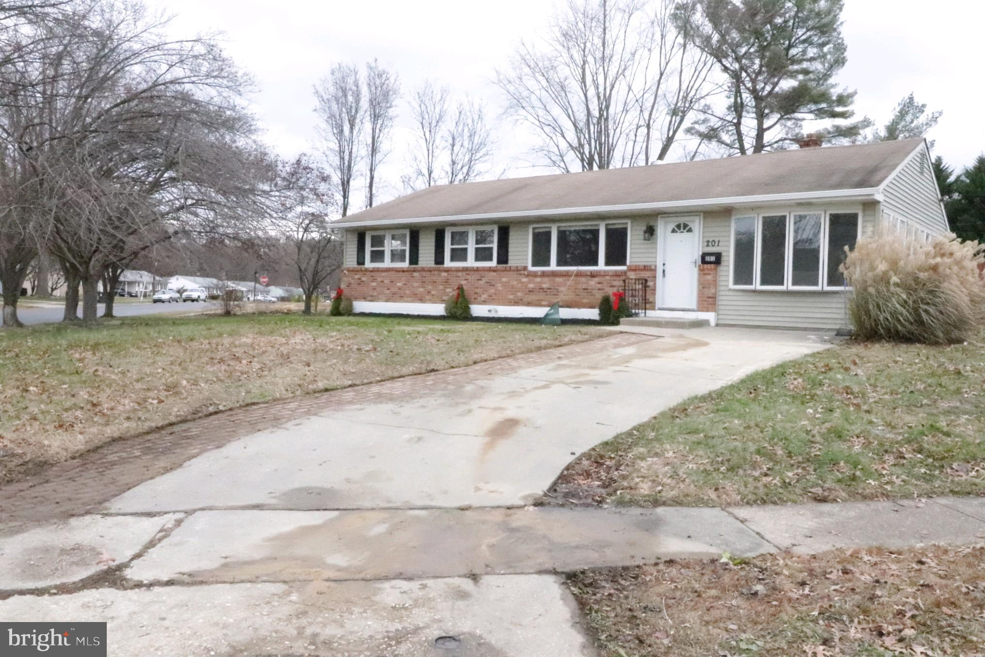 Entertaining is easy in this completely renovated 4 bedroom 2 bathroom ranch home in the beautiful n