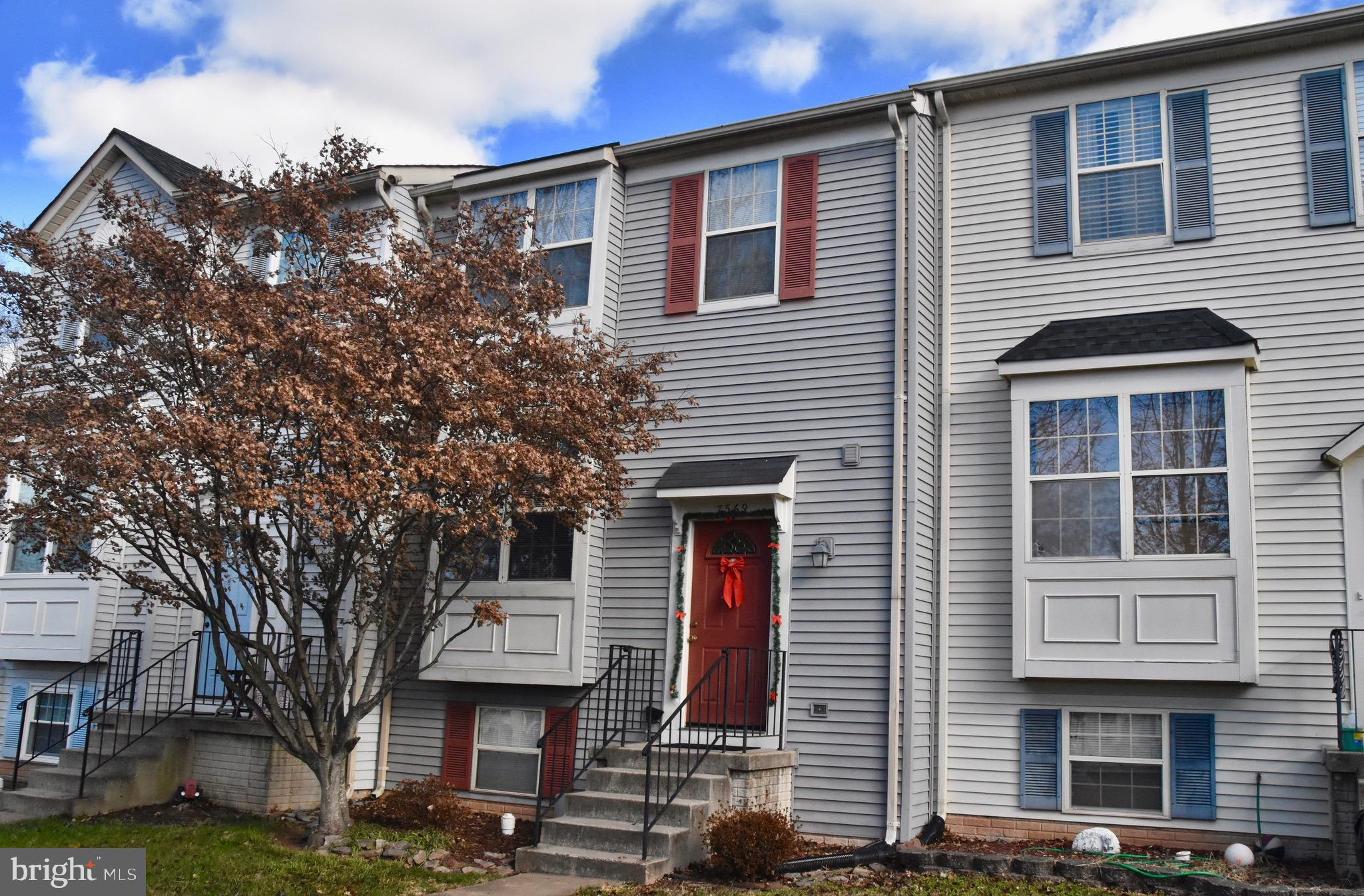 WELCOME HOME! Great town house in a fantastic location. Home backs to thick woods and faces common a