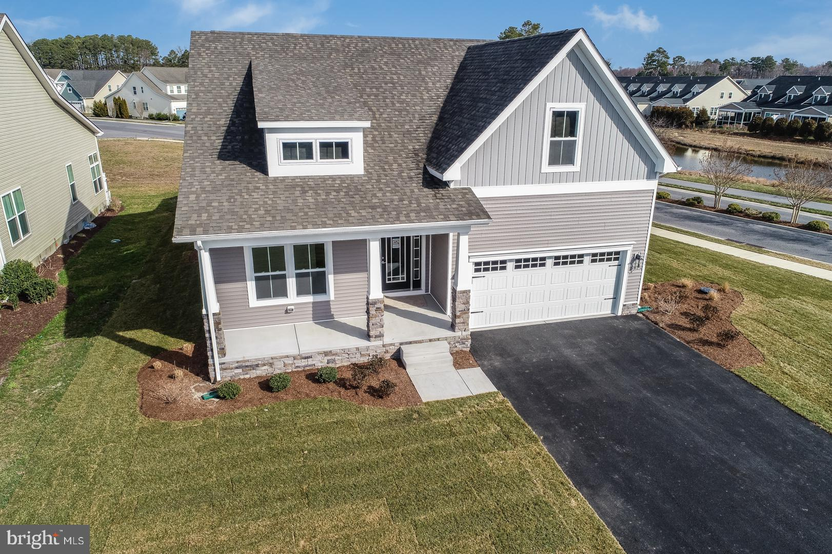 ONE LEVEL LIVING-QUICK DELIVERY! Beautifully designed new construction coastal custom home with a MA