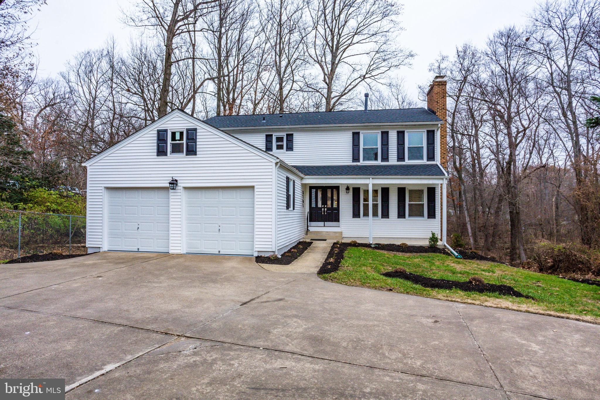 Located in the beautiful Tysons Woods, this 5 bedroom + den, 3.5 bath,  w/ 2-car garage is surrounde