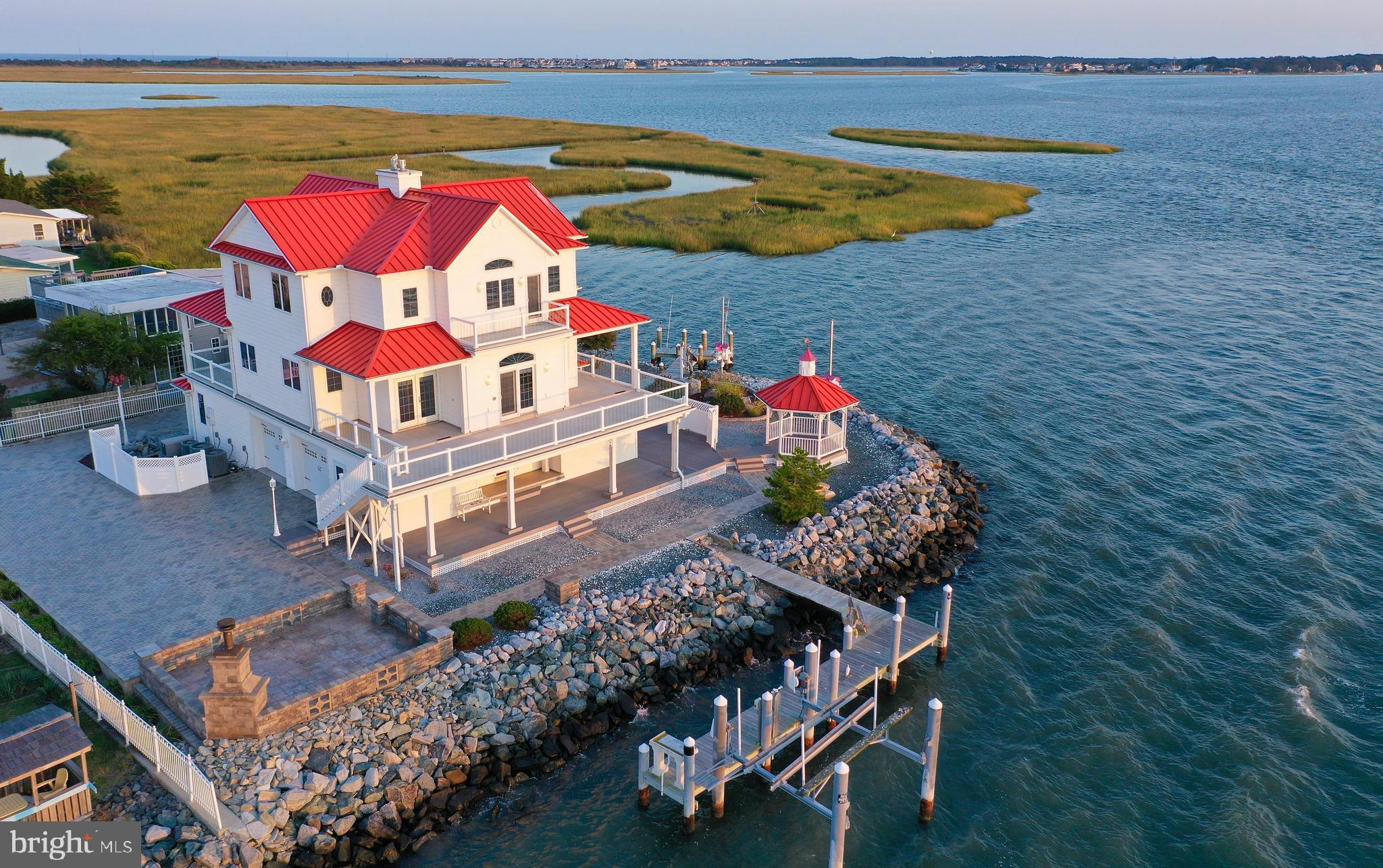 "If You are Looking for a One of Kind, One Off,  Waterfront  Property in the Delaware Beaches with Spectacular Open Bay Vistas this is It! Located inside the Gated Community of ""The Point at Indian River"" this Gorgeous Waterfront Home is Surrounded  Deep Water of the Indian River and Bay Offering Direct Access to the Atlantic Ocean,  This Home  was Built by  the Legendary Delaware  Builder ""Jack Parker"" and was His Personal Home. He Spared No Expense Building this True Waterfront Master Piece. The Property Has its Own Gated Driveway providing Extra Privacy and Security to the Most Discerning Buyer.  Inside this Coastal Home you will find 3 Levels of Coastal Living each providing Unparalleled  Open Bay Views, The Ground Level Features a Large Oversized 2 Garage, In-Law Suite with Full Kitchen and an Elevator that serves all 3 Levels. The Second Level is the Main Living Area with Full Bath and  Gourmet Kitchen with Gas Cooktop Stove, Featuring 3 Large Open and Covered Decks with Commanding Views of the Open Bay and Neighboring Marina,  the 3rd Level is Mainly Devoted the Master Suite & Bath with His & Hers Walk-in Closets, Morning Kitchen, Fireplace and Porch and Decks with Grand Open Vistas the Indian River and Bay, There is also a Second Master on this Level with Access to an Additional Open Bay View Deck, This Home also has Propane Back-Up Generator in case of lose of Power you will be protected, The Main Dock has  Deep Water with ""as is boat lift"" and can accommodate a Large Boat, the Second Dock is Perfect for Launching Canoes or Kayaks with a quick paddle to the Coastal Marshes, This Beautiful Waterway is excellent for all water sports, Excellent fishing from the Dock  with Catches Striped Bass AKA Rockfish, Flounder, and Bluefish to name a few, Also Clamming in the Sand Bar areas is Outstanding and Catching the abundant Blue Crabs is a lot fun too right of your Dock.  This is a True Beach Paradise Offering a Unique Blend of the Best in Coastal Living has Availab"