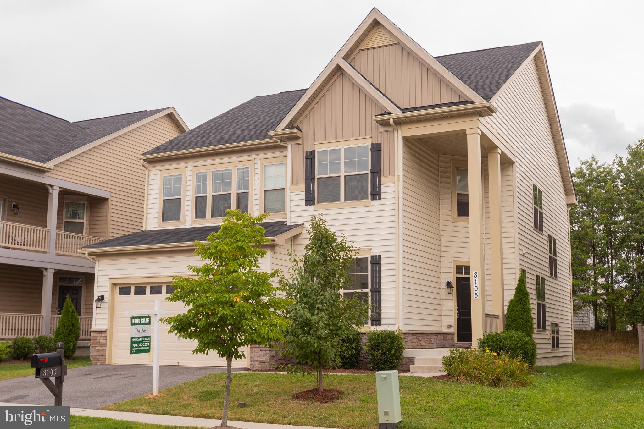 STUNNING & IMMACULATE 5 BEDROOMS & 4.5 BATHS SINGLE FAMILY HOME IN A FANTASTIC COMMUTER LOCATION WIT
