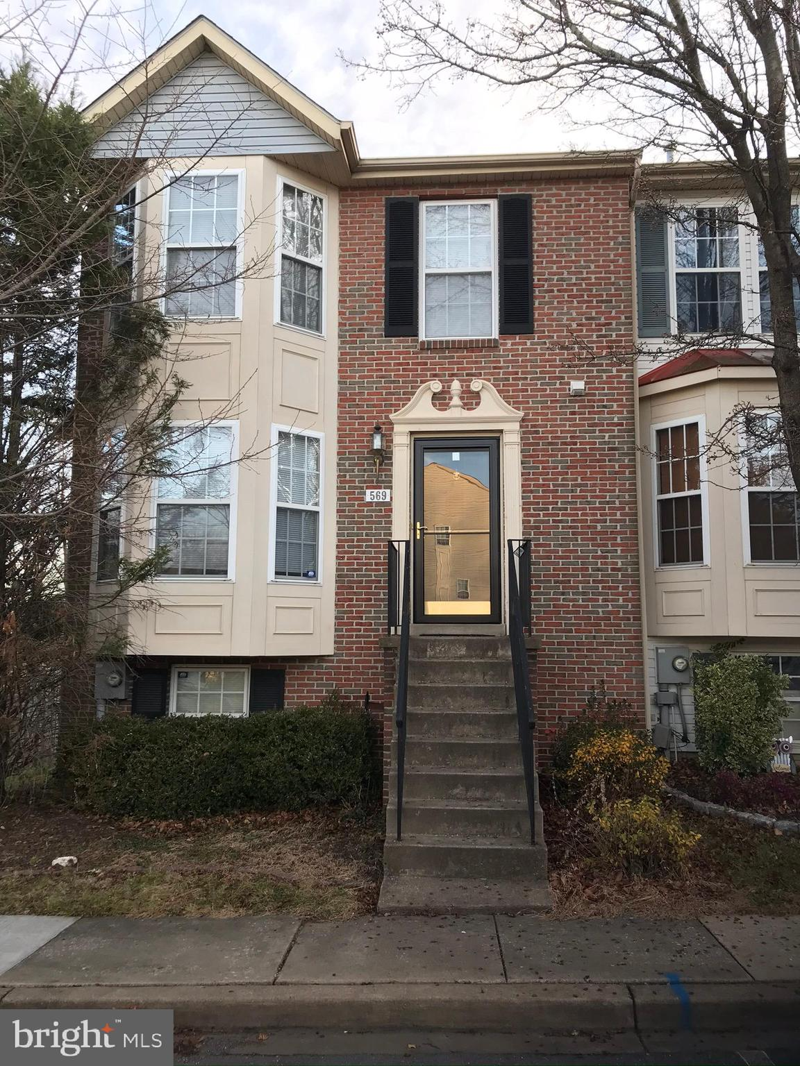 A beautiful end unit townhouse in excellent condition with brick front. A very large living room and