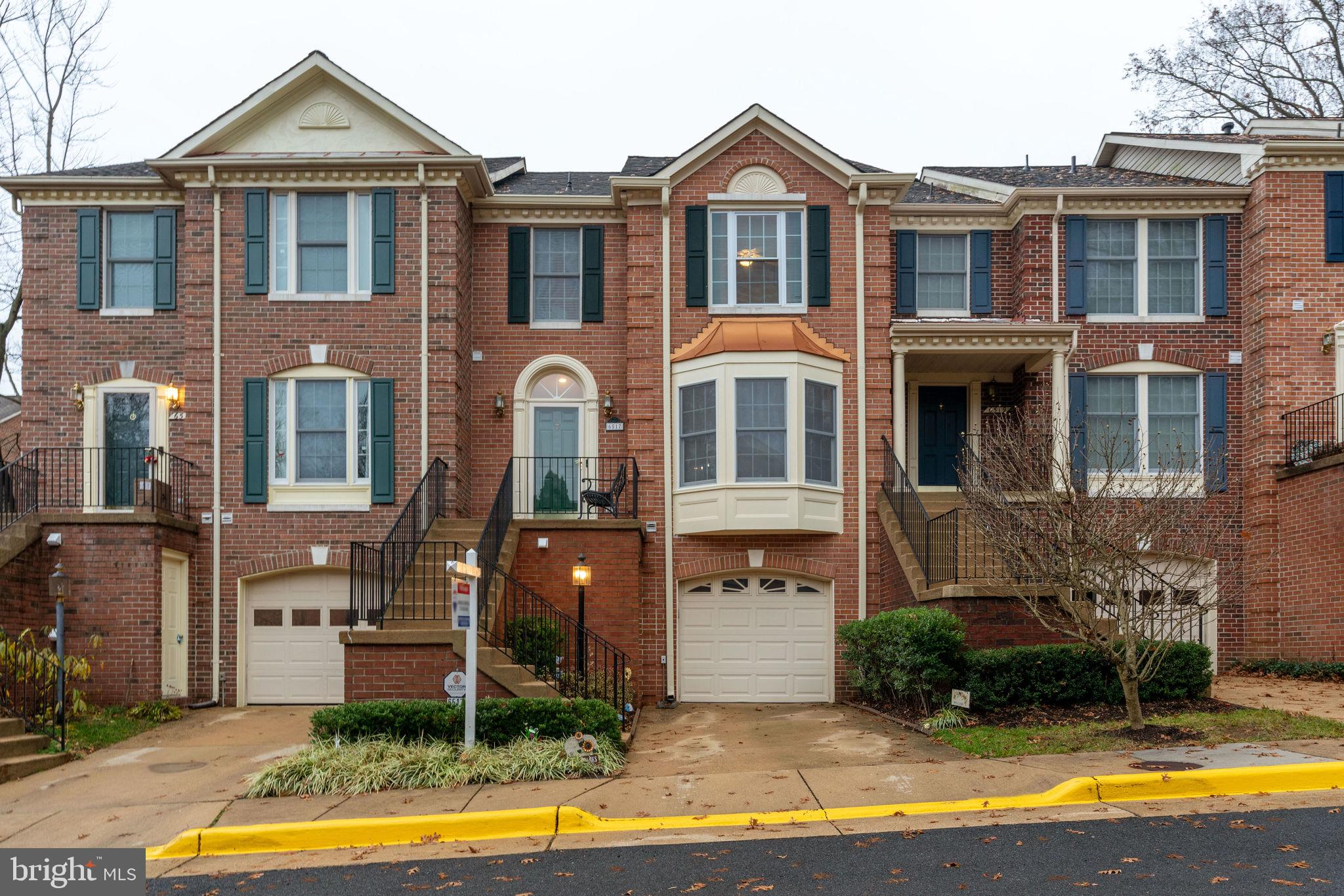 *Fabulous updated and well cared for classic townhome. *Brick front *1 car garage and driveway parki