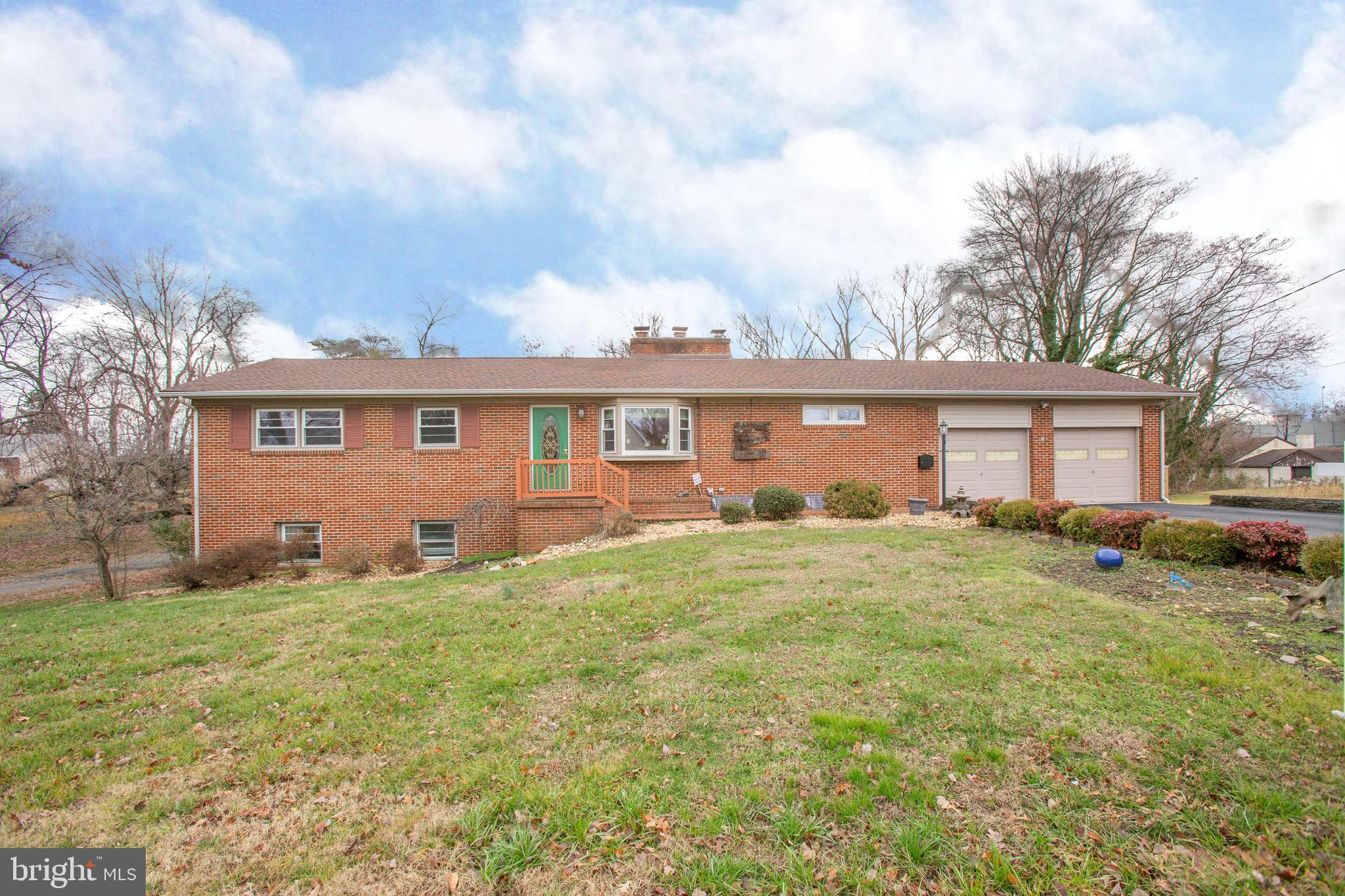 WOW! A little modern, a little retro all in this large renovated rambler! Almost 1/2 acre with separ