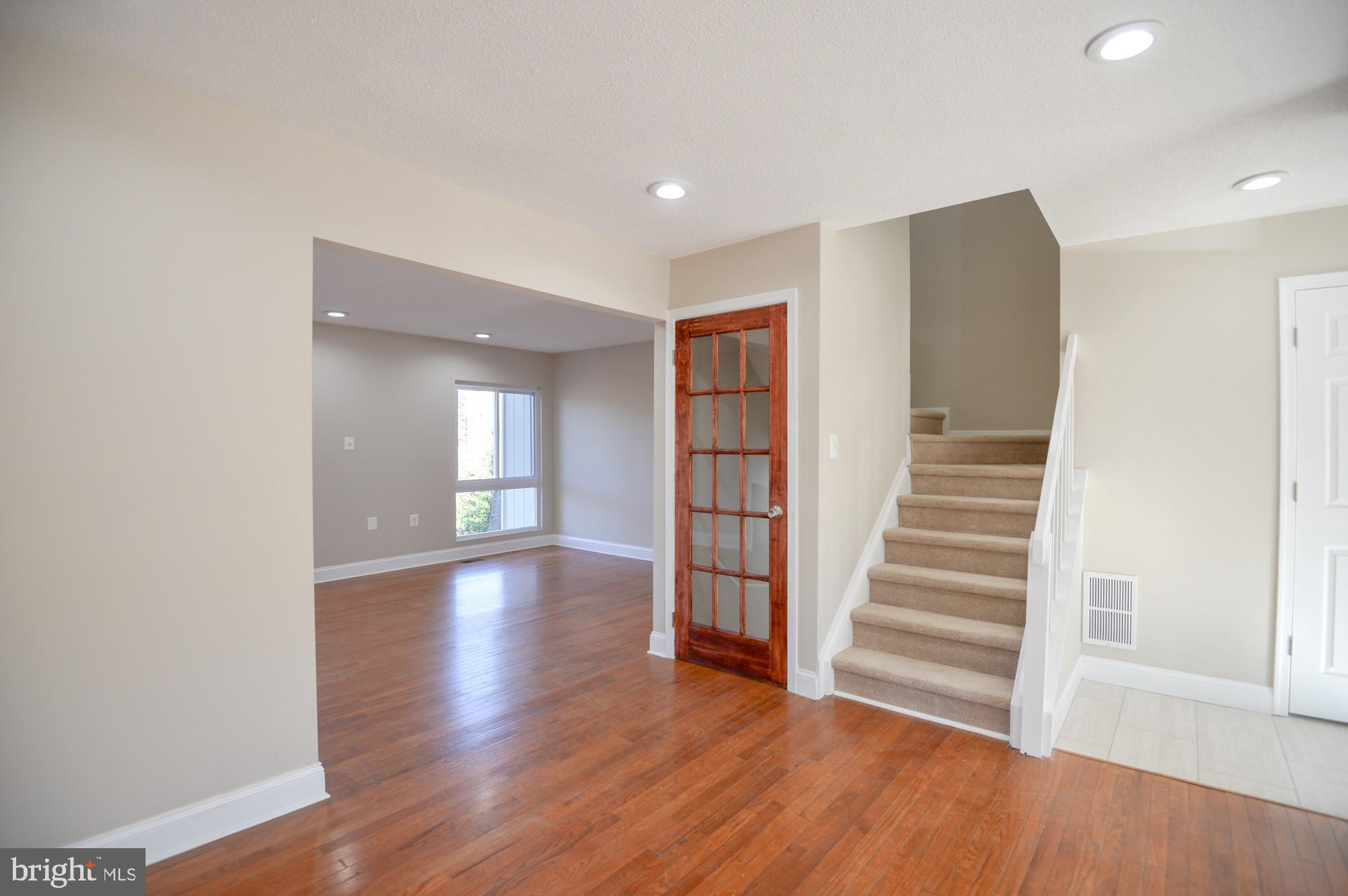 Immaculate and newly renovated 4 bedroom 3 level townhouse, with bright and open concept, recessed l