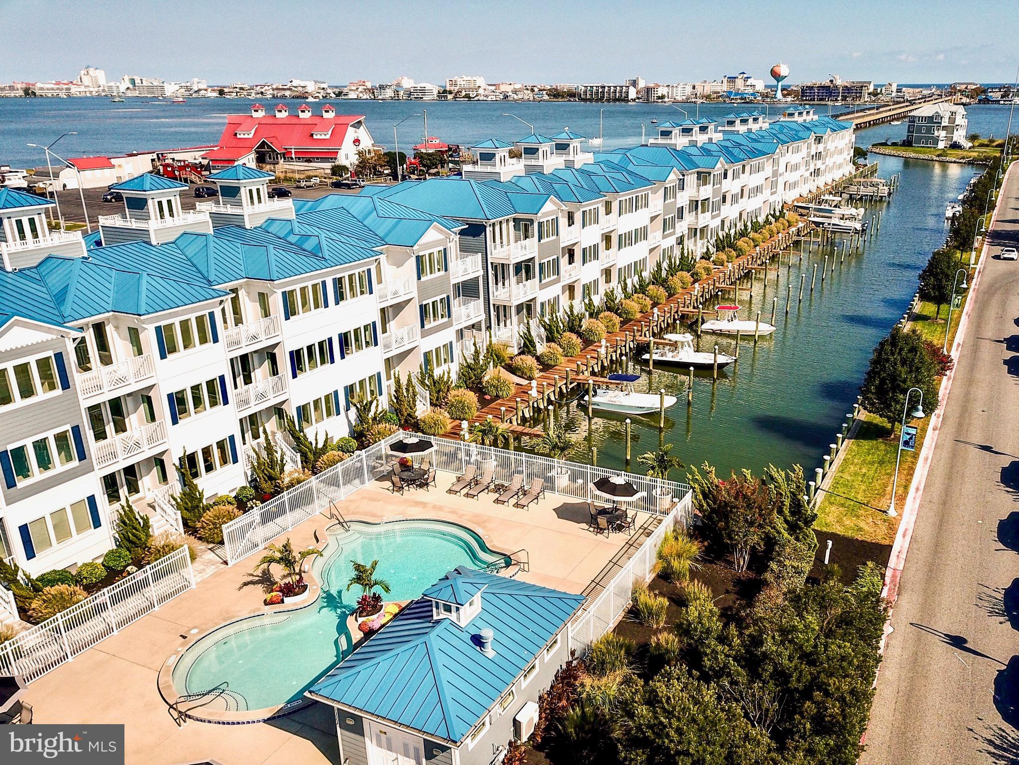 NEW MODEL - JUST RELEASED!!! If you've been looking for a property that will exceed your exceptions in the much sought after location of West Ocean City, look no more!!!!  When nothing but the best will do - The Villas at Inlet Isle is the place for you!!!! These solid concrete block constructed, 3,000 plus sq. ft. luxury townhomes offer 3 and 4 bedroom units with impeccable attention to detail and quality finishings throughout.  Unit 9  offers 3 spacious bedrooms with additional space that can be used as a 4th bedroom or second master suite and conveys with a wide 30 ft. boat slip, all slips have access to water and electric. Every unit has 4 full bathrooms, custom walk-in showers, a private elevator, two car garage, soaring 9 ft. ceilings and crown molding throughout, plenty of tall windows and doors to allow an abundance of natural daylight inside, outdoor living space on every level. Unit 9 has an absolutely stunning custom gourmet kitchen with beautiful calacatta quartz countertops, a very large kitchen island that seats 4 comfortably, upgraded stainless steel appliances, separate dining area and spacious living areas. Extremely spacious master ensuite with sitting area, his and hers walk-in closets, double bathroom vanities, double custom walk-in shower, private balcony overlooking the marina and views of the OC Inlet. Incredible OC skyline, marina, and open bay views from almost every room.  Community dock, southern exposed heated community pool w/bathhouse & outdoor shower. 30 and 38 ft. boat slips available.  Stop in the sales office Thursday-Monday 11-4 or schedule a private showing. Property taxes shown in this listing are estimated.