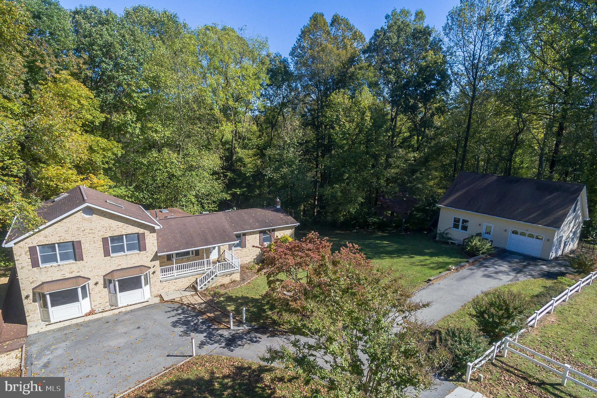 Have you been searching for a GREAT DEAL? THIS IS IT! Just reduced to an amazing $449,999!!! Located in Northern Most Calvert County in Owings on 3 private acres at the end of a quiet cul-de-sac. Look what you get for this low, low price: Over 3,100 sq. ft. of finished space, lovingly maintained and move-in ready. Blue ribbon schools, easy commute to downtown Washington, Annapolis and Joint Base Andrews. Seven skylights and Andersen windows bring the great outdoors inside. Updated kitchen features granite counters, new kitchen cabinets and custom pull-out pantry. Private master suite includes separate sitting room with hardwood floors, new carpet in bedroom and walk-in closet. Enormous Great Room (24~ x 23~) features bay windows and private entry to rear deck and ramp. The downstairs apartment provides privacy and independence for extended family, guests, or additional living space for any of your personal needs. Its kitchen features extra storage in cabinets, sink, microwave, full-sized refrigerator and washer/dryer. A private entrance opens to a screened-in porch. Outside you~ll find four porches overlooking three quiet acres of trees, birds and wildlife. Lot could accommodate an area suitable for animals. And as if that wasn~t enough, at the other end of your driveway you~ll find the ultimate workshop (47~ x 35~), detached office outside of the home, and a 1 car garage. Fully finished with ten-foot ceilings, reinforced floor, electricity, heat and air, it includes a single car garage bay, attached lean-to and full-sized, floored second story. Most homes in this location with this square footage and this acreage, will be priced way higher! Come tour this one-of-a-kind home for yourself and fall in love.