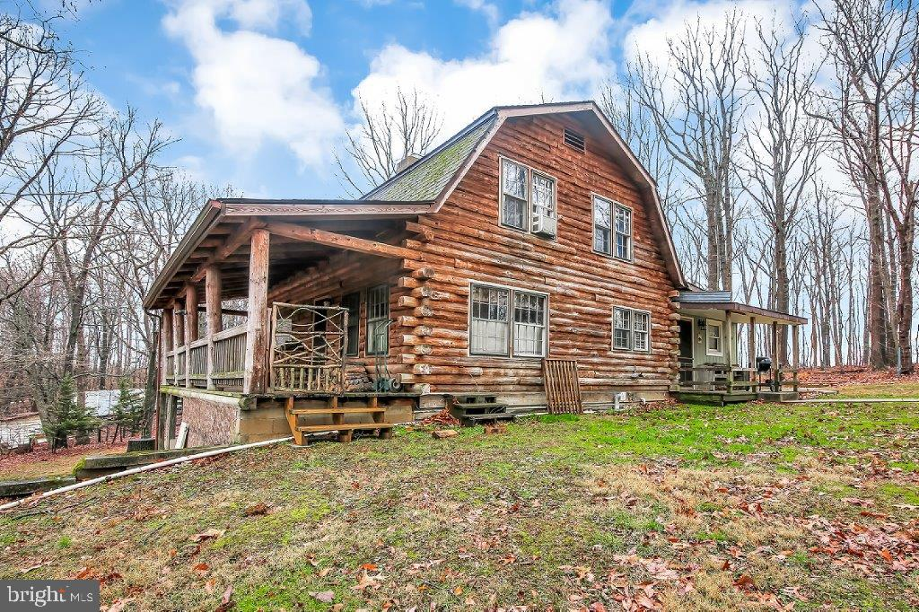 Log Cabin Living!! Charming 4 bedroom, custom Cape Cod Log Home nestled on a 1.73 secluded acre lot