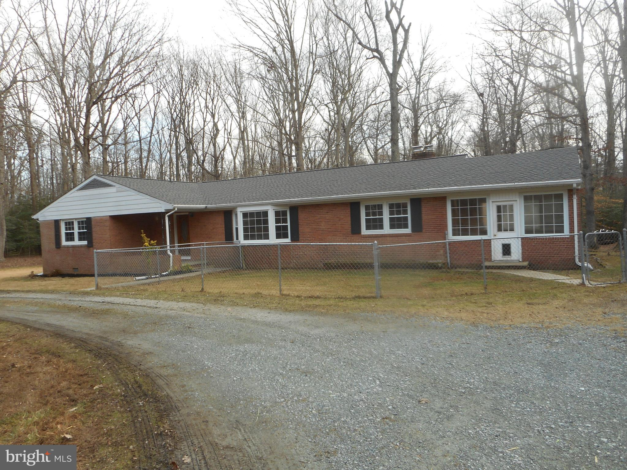 All brick rambler that sits on a acre lot that backs to trees for that added privacy.   This home features a formal living room, dining room  a separate family room plus a enclosed sun room for your all year round enjoyment.   Located on a rural road it still offers easy access to the Washington DC metro area.  This is a Fannie Mae HomePath property.