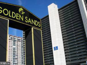 A REAL DEAL!!   RECENTLY REDUCED! Direct Oceanfront Efficiency - priced ready to sell!  1st Floor unit... use elevators or take the stairs on busy times!!  Super easy access to beach with stairs just to the left of door!  Come & enjoy the amenity rich Golden Sands and leave  your cares at home.  ONE OWNER  since 1989. Great Balcony for direct ocean views and with  just a little TLC you could have a place at the beach!  Could be good investment or perfect for summer fun for you. Super amenities with indoor and outdoor pools, kiddie pool, game room, fitness center, sauna, private beach area, tiki bar/restaurant and on site 24 hour security.  Basic Cable included in Condo fee too! Also included is 1 covered parking space (#60) and outdoor storage space.
