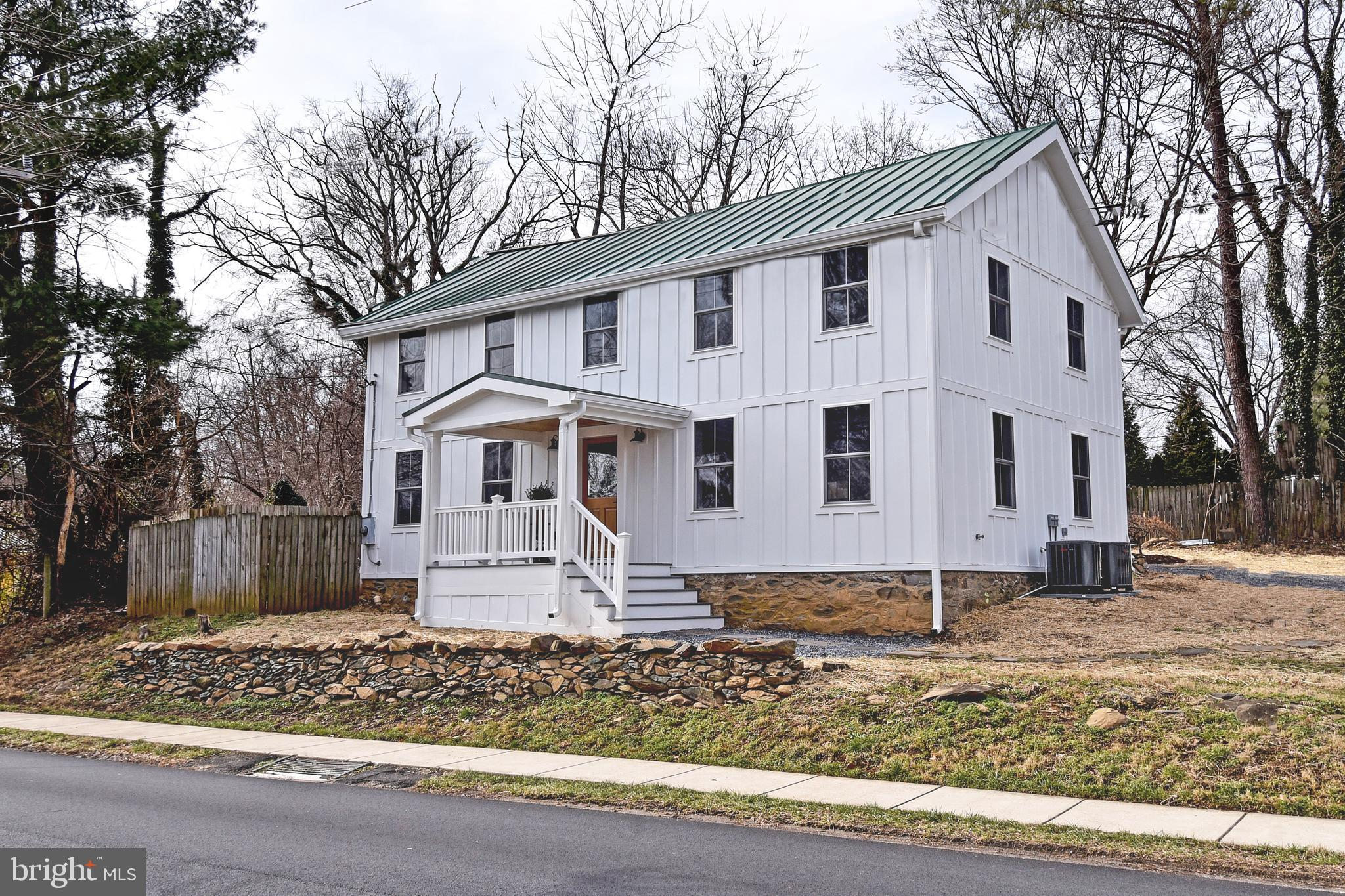 Completely renovated and updated, this three bedroom, two and a half bath home in historic Round Hil