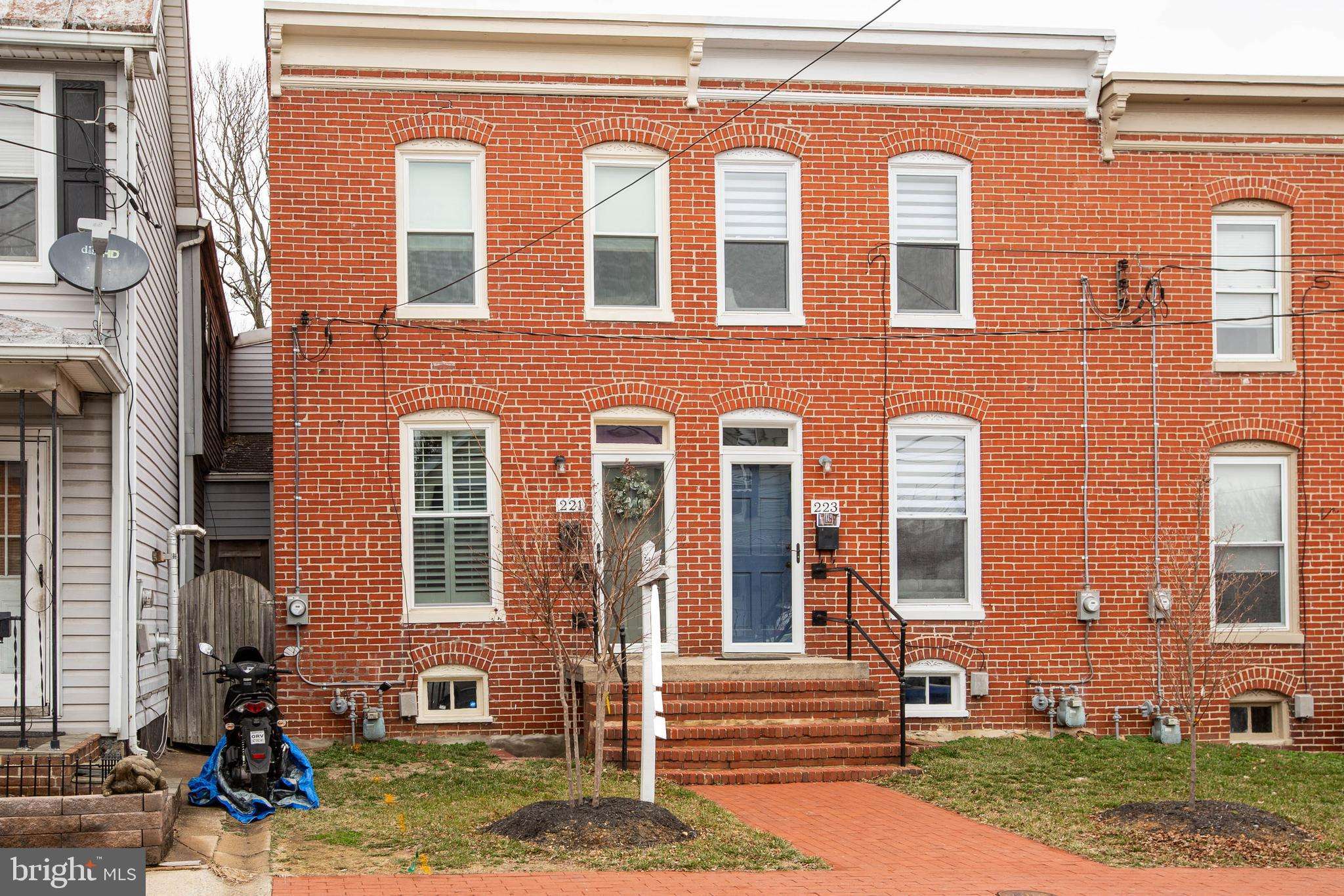 What a cutie! All Brick and completely renovated in 2019 ready for you to call home in Frederick City Downtown! Features 2 lovely bedrooms and a full bath, all hard wood floors, beautiful kitchen with style and class, curved stairs to the upper bedrooms and full bath, tucked in to a comfortable and homey floor plan sure to please.  Spacious parking and grassy area awaits you in the back yard for plenty of entertainment room.Home Warranty is in place for this newer renovated home in 2019!