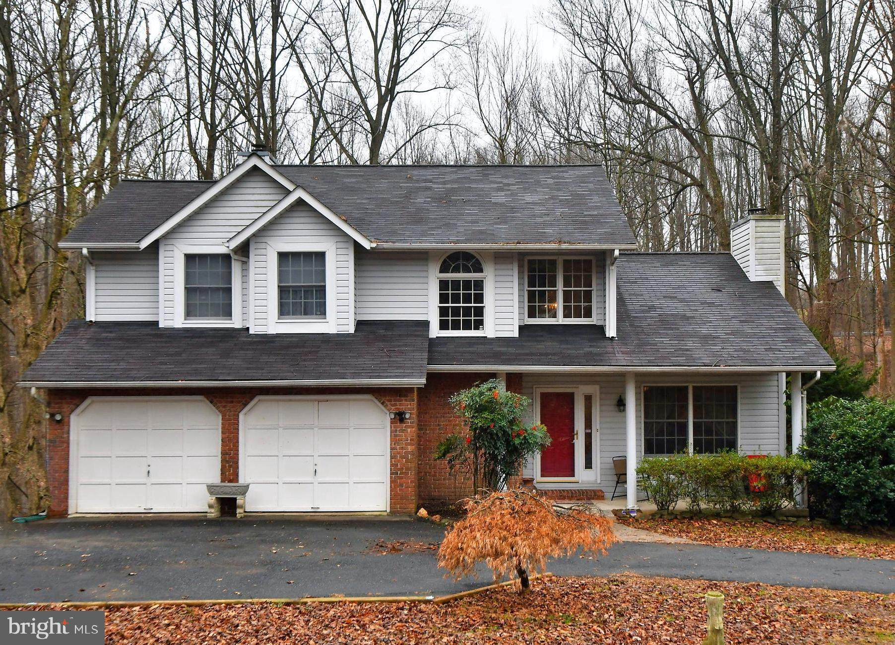 Contemporary Styling evident in this 2 story nestled into the woods on a private 1.2 acre lot! Open