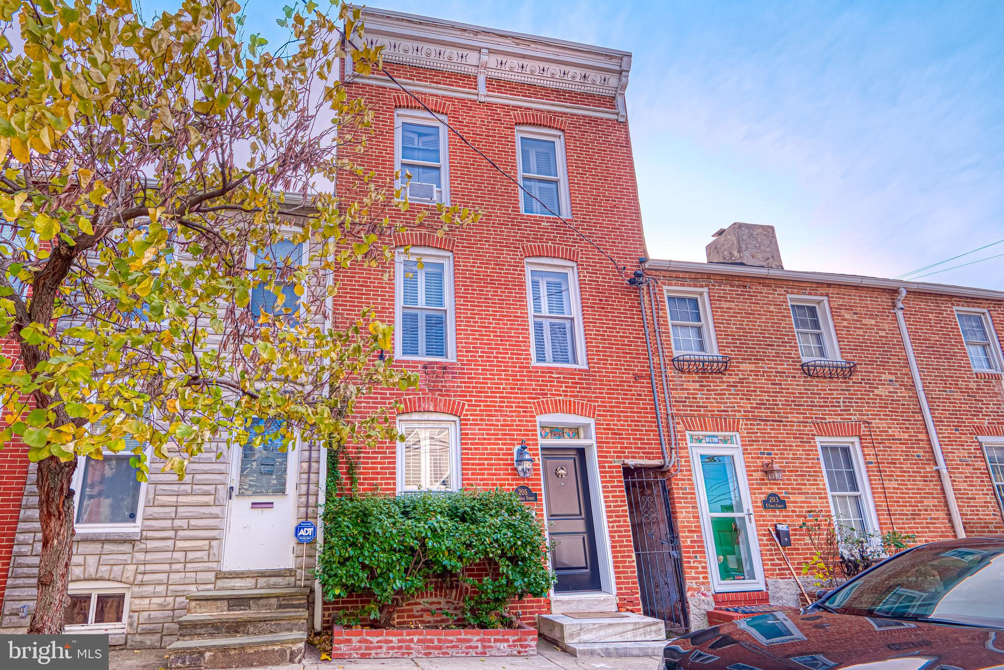 Three story home in the Heart of Federal Hill. Walk to Fed Hill Park, the Inner Harbor, Stadiums and more. Easy access to 95 and the Marc train. Home features spacious 3 above grade BR floor plan with hardwoods throughout and exposed brick. Living room with gas fireplace & built-ins, separate dining/family room, eat-in kitchen with stainless appliances, skylights and brand new granite counter and backsplash. Third level Master suite with private renovated bath, two tiered TREX roof deck with amazing city views. Basement storage.