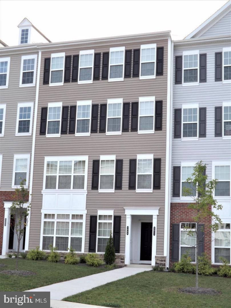 Large 3 Bedroom Town Home with 1 Car Garage, Huge Eat-In Kitchen with Granite Countertops, Hardwood Floors, Pantry  and Stainless Steel Appliances with Balcony.  Spacious Master Bedroom with Gorgeous  Master Bath.  Bedroom Level Laundry.  2400+ SQFT. Freshly Painted. Move-In Ready. Just minutes from I-95, VRE, and Shopping.  You will not be disappointed when you view this property.