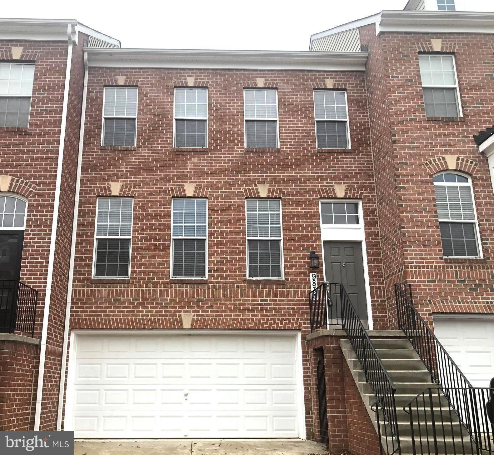 Stunning Brick-Front Townhouse located  in the prestigious development of Emerson at Skylark Ridge i
